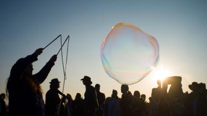 A reveller creates bubbles as she celebrates the summer solstice on Salisbury Plain in southern England June 21, 2014. Stonehenge is a celebrated venue of festivities during the summer solstice - the longest day of the year in the northern hemisphere - and it attracts thousands of revellers, spiritualists and tourists. Druids, a pagan religious order dating back to Celtic Britain, believe Stonehenge was a centre of spiritualism more than 2,000 years ago.