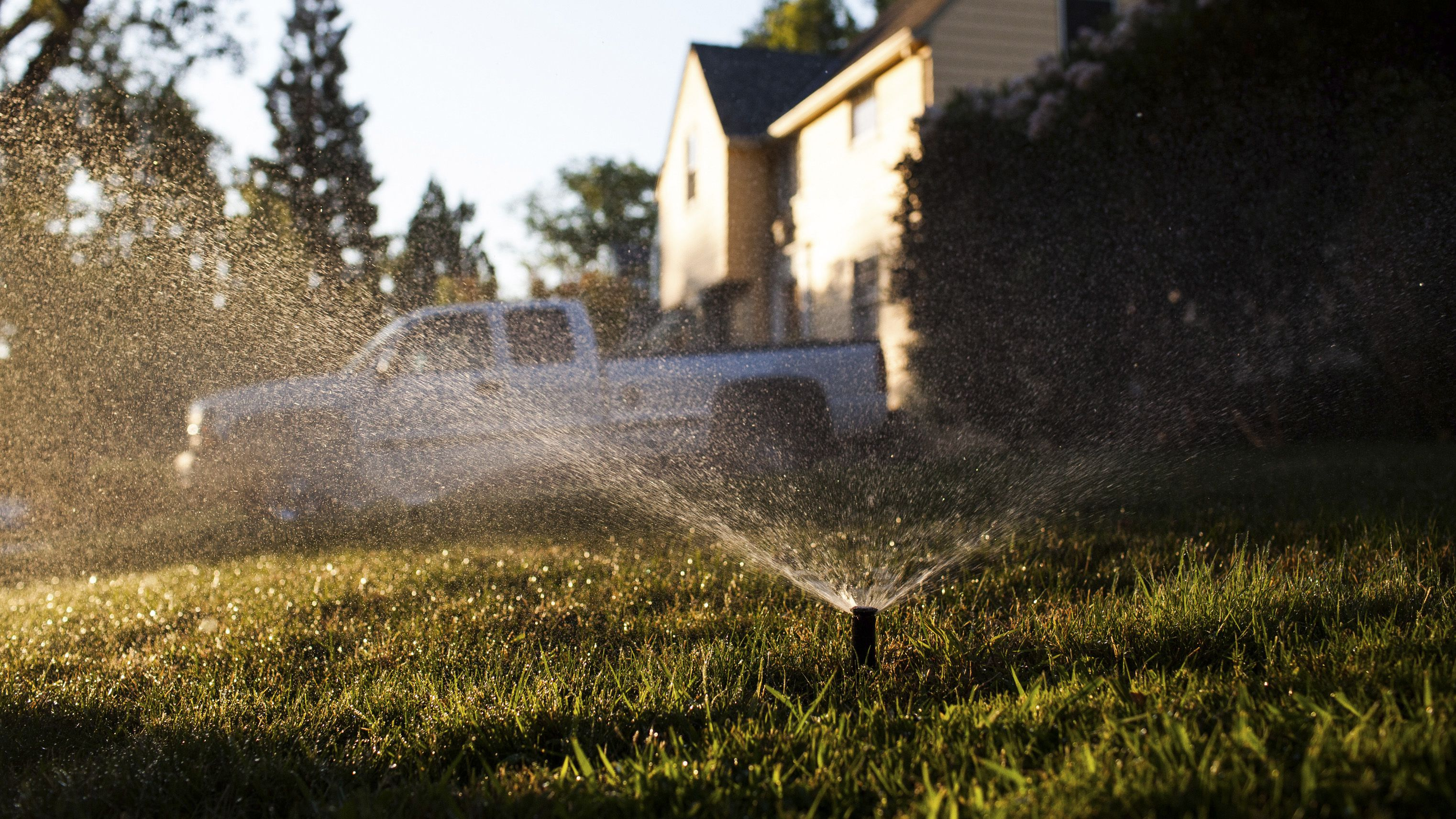 """california hydrant water theft thieves black market water usage siphon illegal drought Sprinklers spray water at a home in Sacramento, California on a mandatory """"no watering"""" day, August 15, 2014. Penalties for illegal watering in Sacramento range from a warning for the first violation to a $1000 fine for the fourth violation. Water regulators in California approved tough new conservation measures last month to limit outdoor water use. California is in the third year of a catastrophic drought that has diminished the Sierra Nevada snow pack, which normally feeds the state's rivers and streams with cool water. REUTERS/Max Whittaker"""