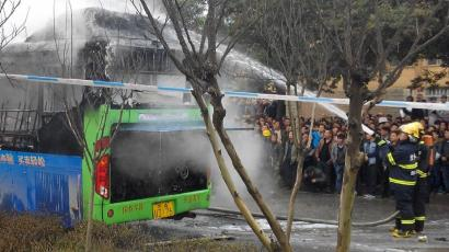 china pboc people's bank of china liquidity injections Firefighters hose down a bus as they try to put out the flames on the burning vehicle on a street in Guiyang, Guizhou province, February 27, 2014. According to Xinhua News Agency, the bus burst into flames shortly after noon on Thursday, leaving five people dead, 30 others injured. The cause of the fire was unclear and investigations were underway, according to local authorities.