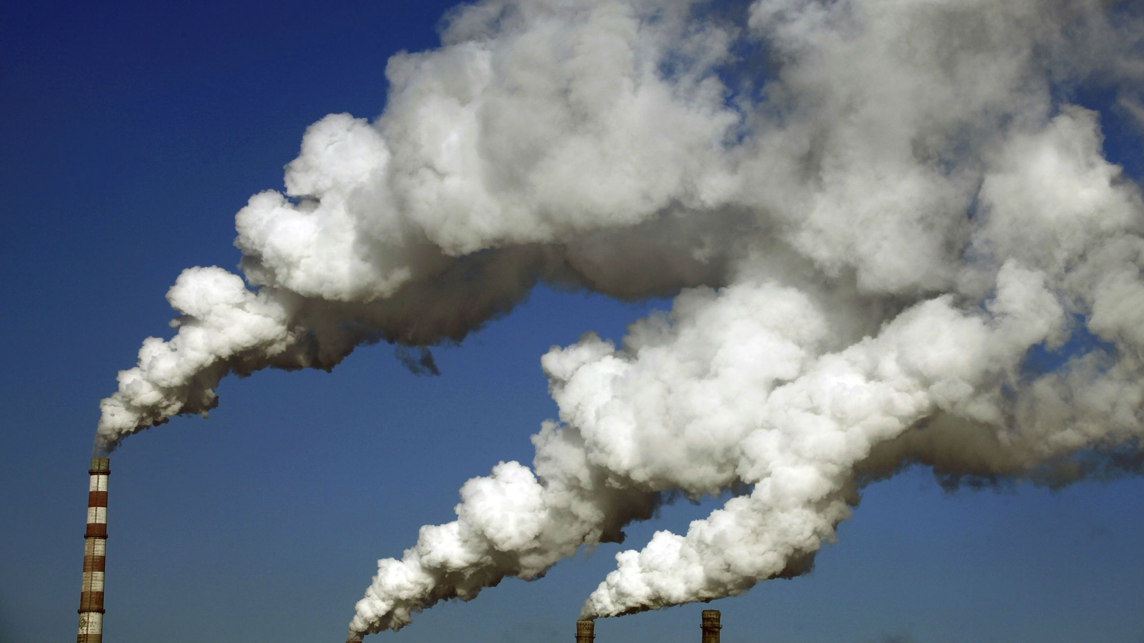 Smoke billows from the chimneys of a heating plant in Jilin, Jilin province January 8, 2014.