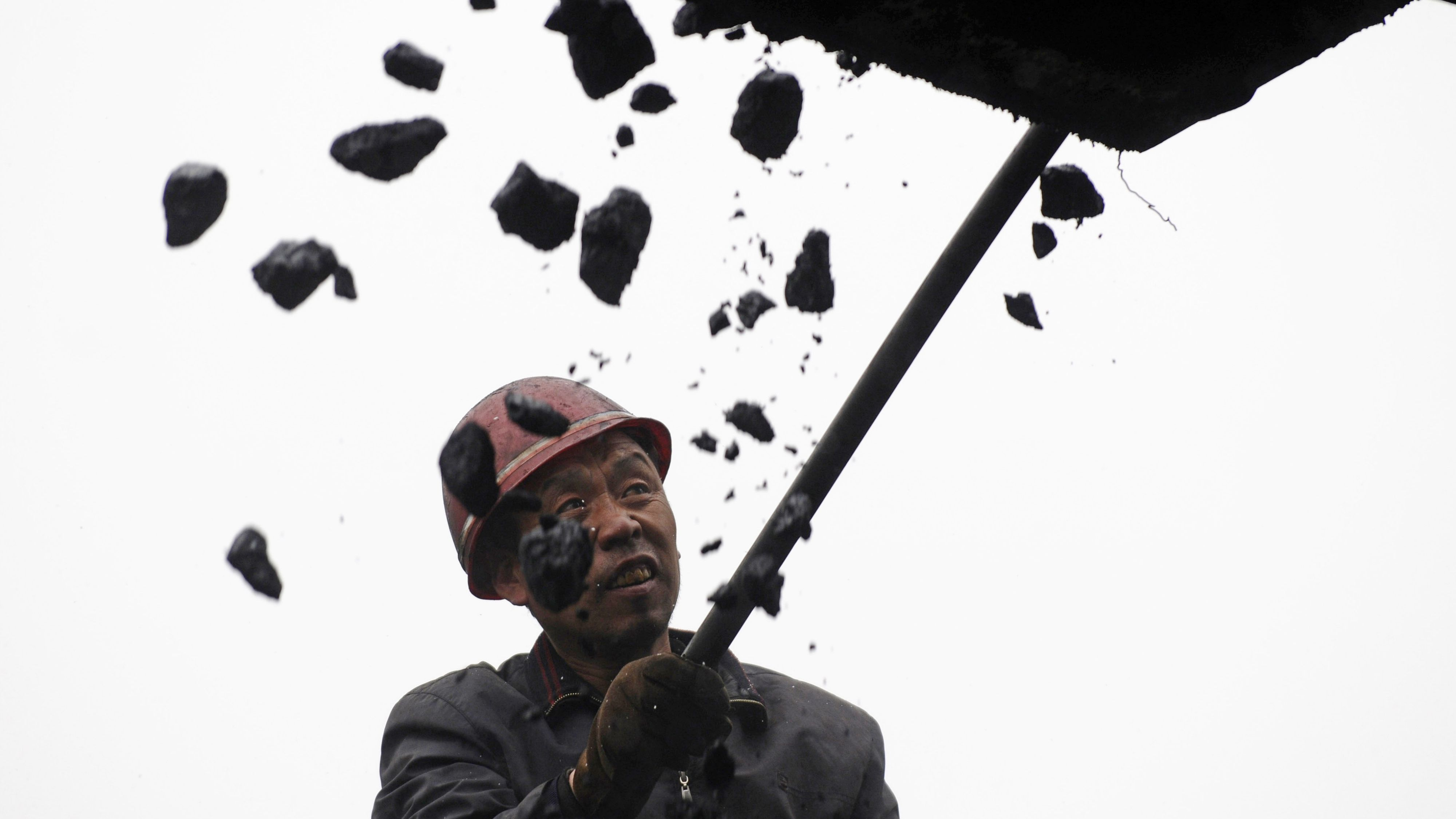 china rebalancing stimulus A miner works at a coal mine in Changzhi, Shanxi province February 26, 2009. China's energy use in generating each dollar of gross domestic product fell 4.5 percent in 2008, Liu Qi, deputy administrator of the National Energy Administration said on Thursday. REUTERS/Stringer