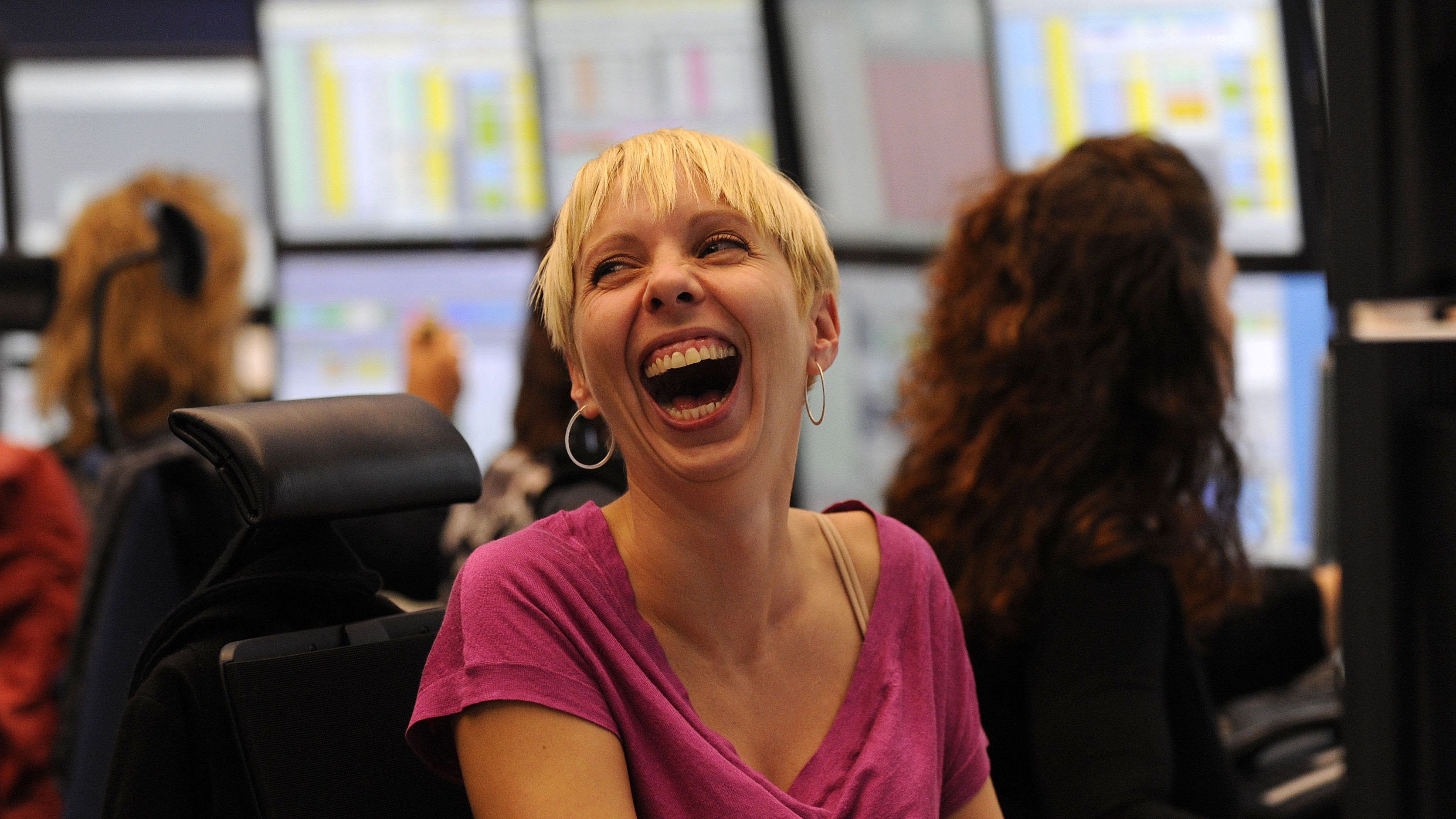 A share trader reacts as she sits behind her trading terminal at the Frankfurt stock exchange, October 13, 2008. REUTERS/Kai Pfaffenbach(GERMANY)