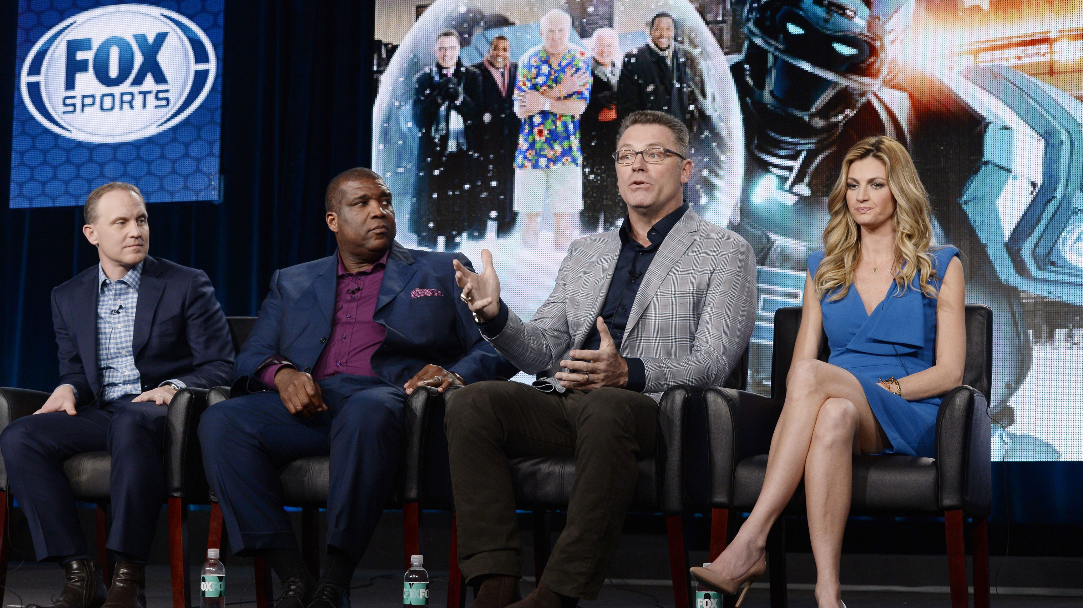 Executive producer Eric Shanks (L-R), host Curt Menefee, analyst Howie Long, and pre-game and game reporter Erin Andrews talk about the FOX Sports television coverage of the Superbowl XLVIII during Fox Broadcasting Company's part of the Television Critics Association (TCA) Winter 2014 presentations in Pasadena, California, January 13, 2014.