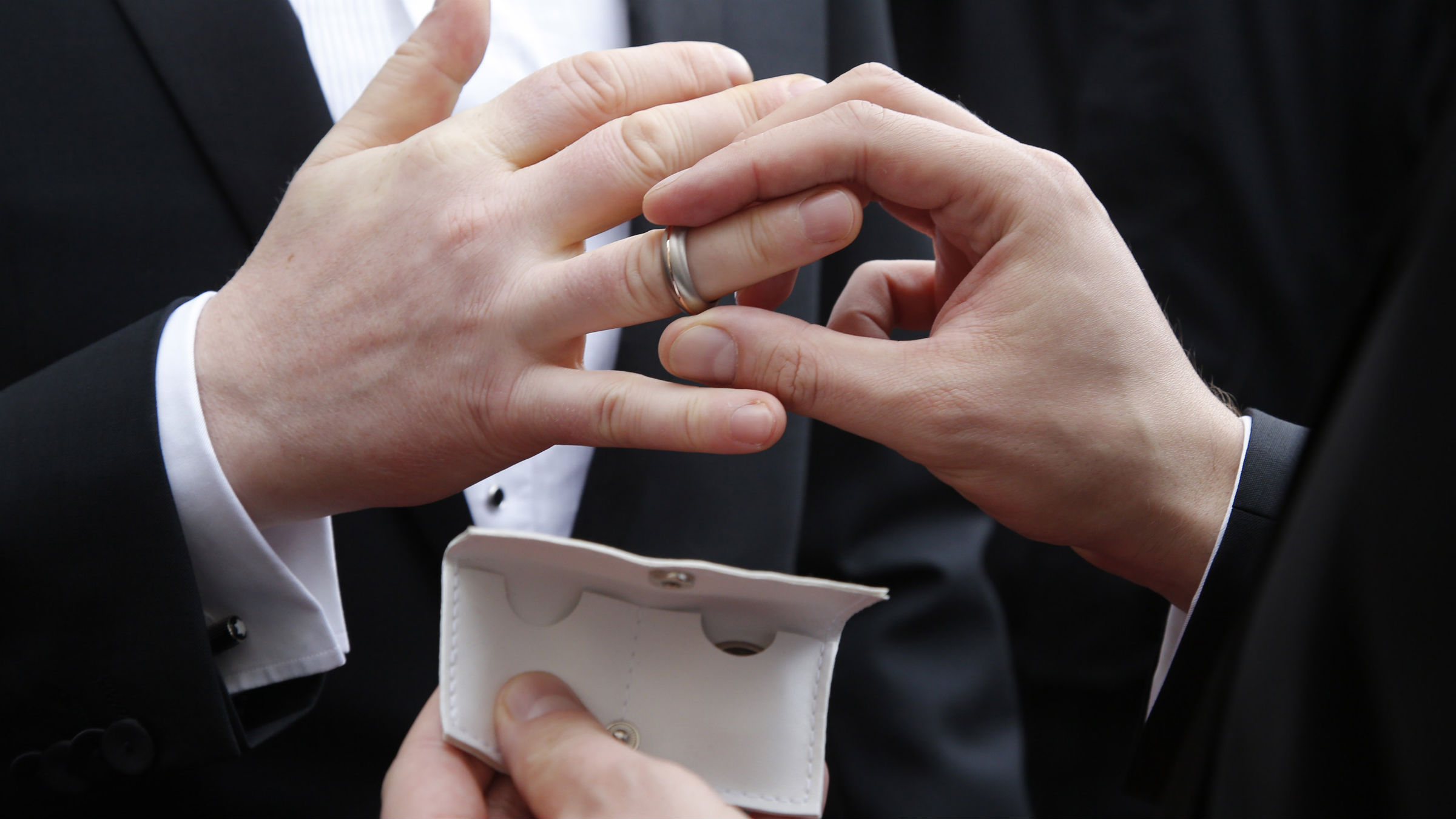 Gay couple Holger Schmitt (C) and his husband Alexander Nicolai exchange rings after being married by Copenhagen's Mayor Frank Jensen, in Copenhagen May 9, 2014. Several gay couples were married by the Copenhagen mayor on Friday prior to the grand final of the 59th annual Eurovision Song Contest on May 10.