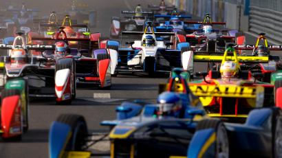 Formula E cars drive into a corner during the Formula E Championship race in Beijing September 13, 2014. The inaugural Formula E Championship, which according to its organisers is the world's first fully electric racing series, will be contested by 10 two-driver teams over 10 rounds. REUTERS/Barry Huang (CHINA - Tags: SPORT MOTORSPORT SCIENCE TECHNOLOGY) - RTR462K9