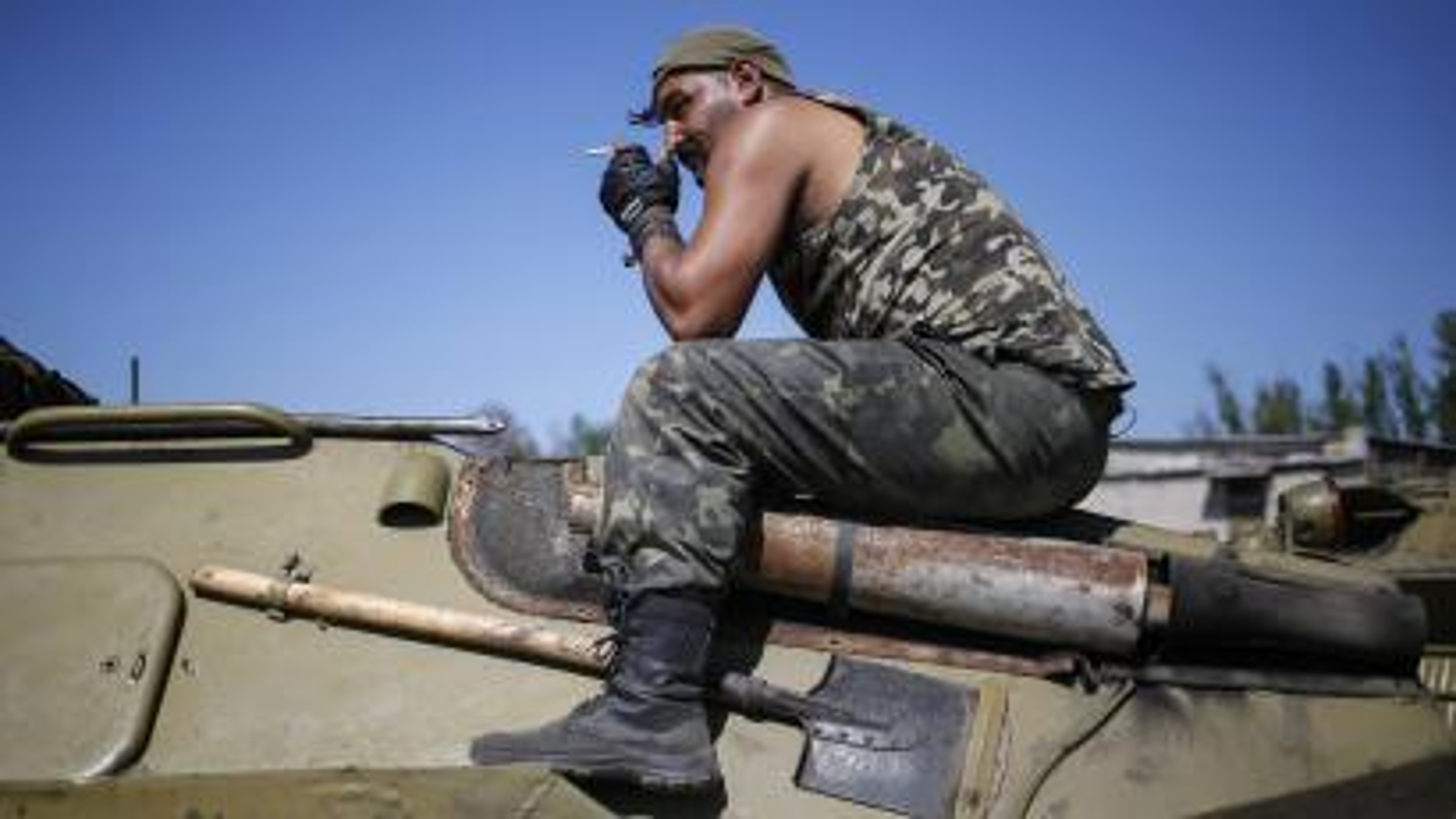 A Ukrainian serviceman smokes as he sits on an armoured vehicle near Kramatorsk September 4, 2014.