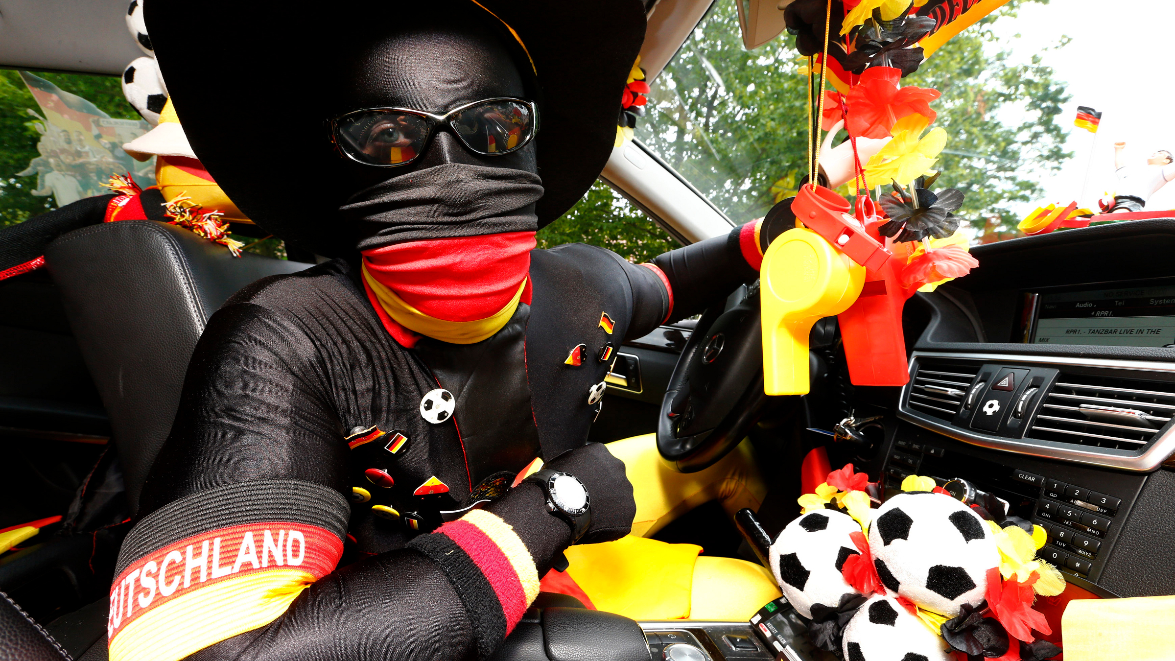 Marcel Klingbiel, a taxi driver and fan of the German national soccer team, poses in his decorated taxi in Ramstein July 6, 2014.