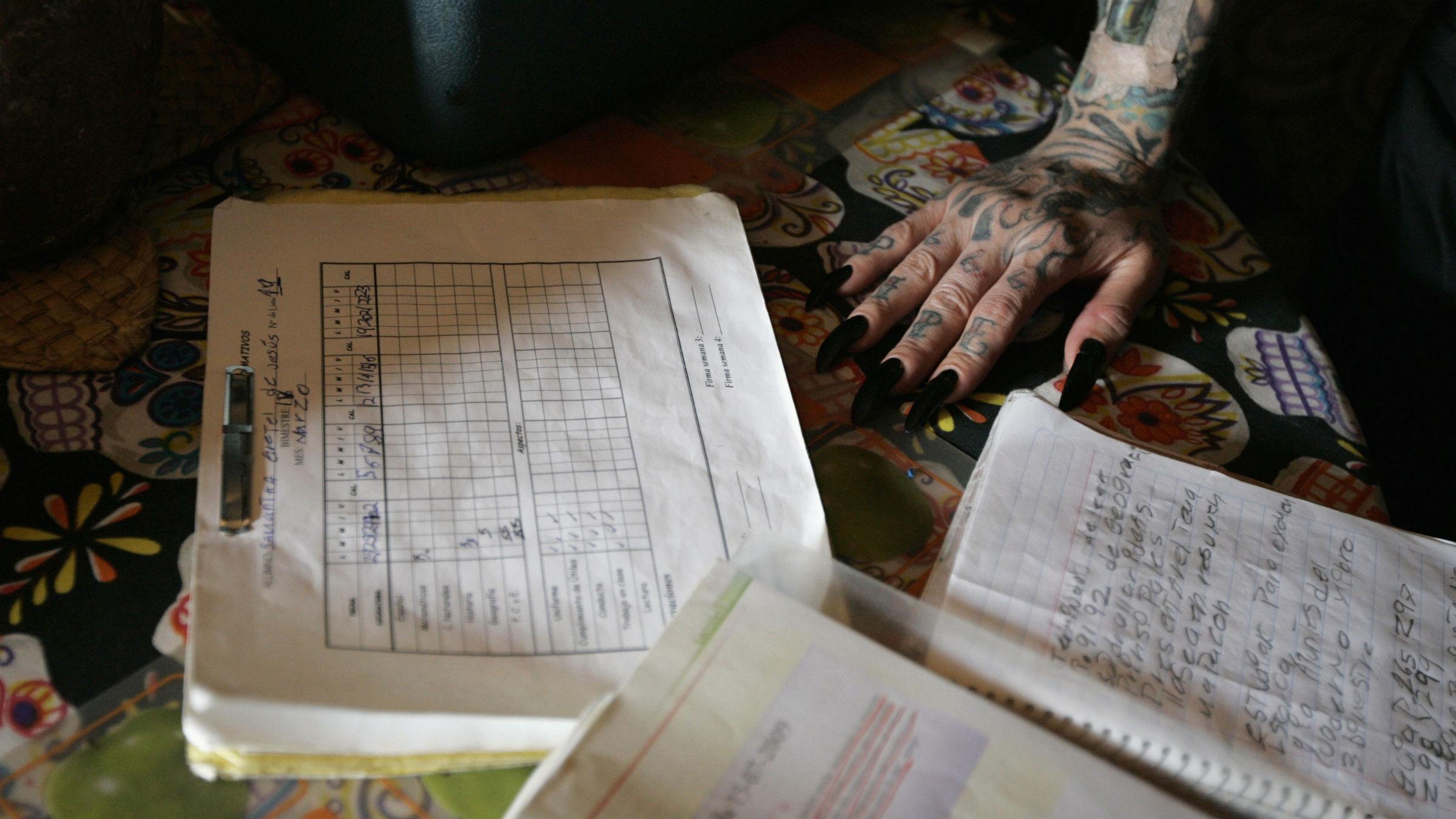 Hand next to homework