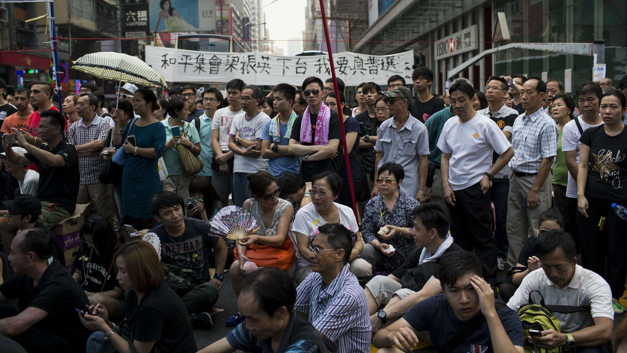 Protesters attend a rally at a main street at Mongkok shopping district in Hong Kong September 30,2014.