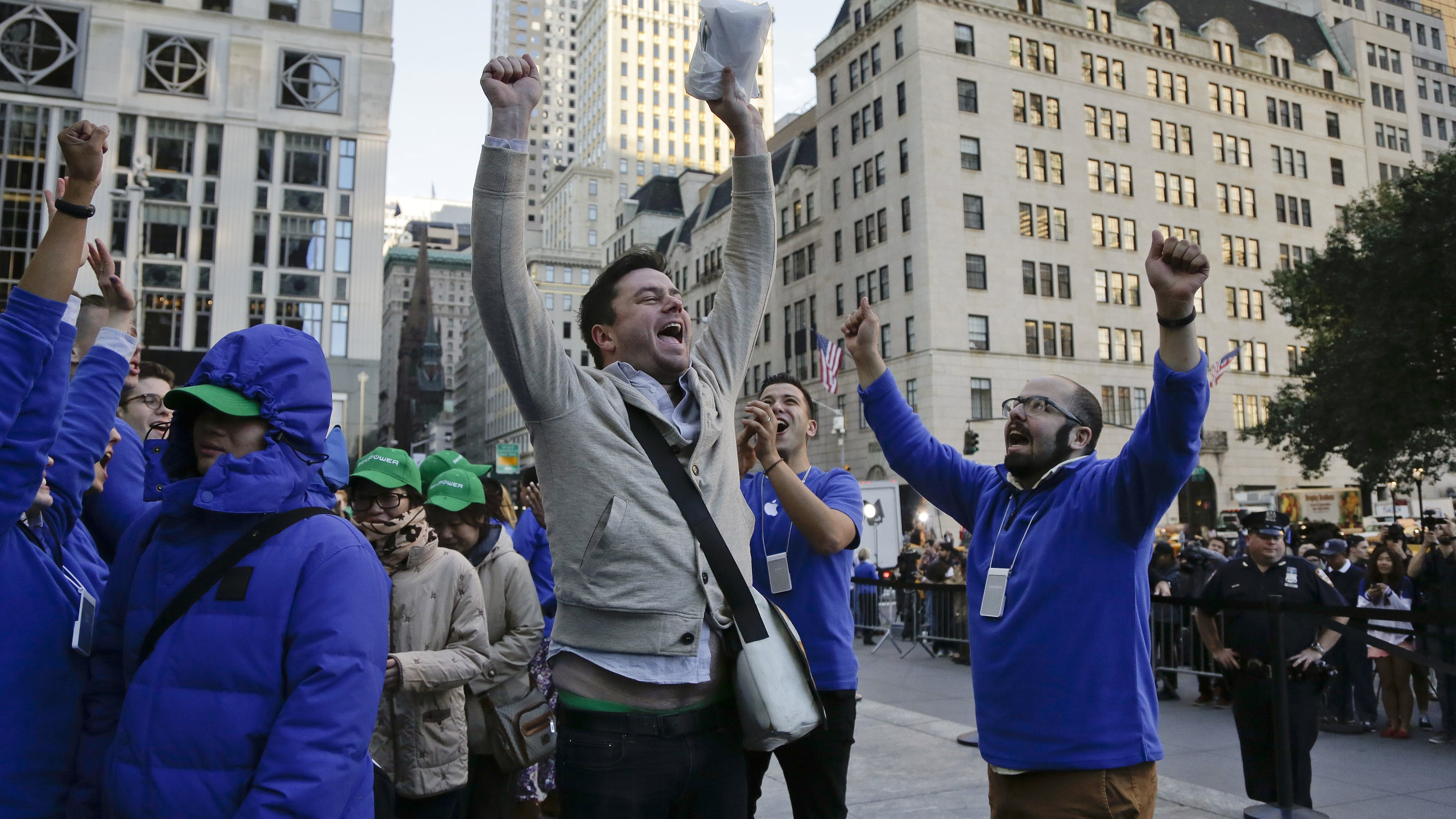 Andreas Gibson celebrates as he exits the Apple store after being the first to purchase an iPhone 6 Plus, Friday, Sept. 19, 2014, in New York. The highly anticipated iPhone 6 and iPhone 6 Plus are being released in stores today. (AP Photo/Julie Jacobson)