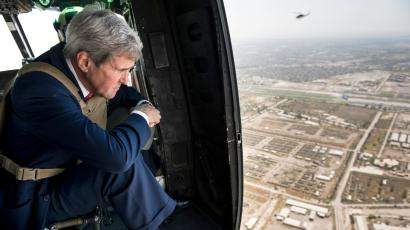 U.S. Secretary of State John Kerry looks out over Baghdad from a helicopter September 10, 2014. Kerry arrived in Baghdad on Wednesday as he began a tour of the Middle East to build military, political and financial support to defeat Islamic State militants controlling parts of Iraq and Syria.