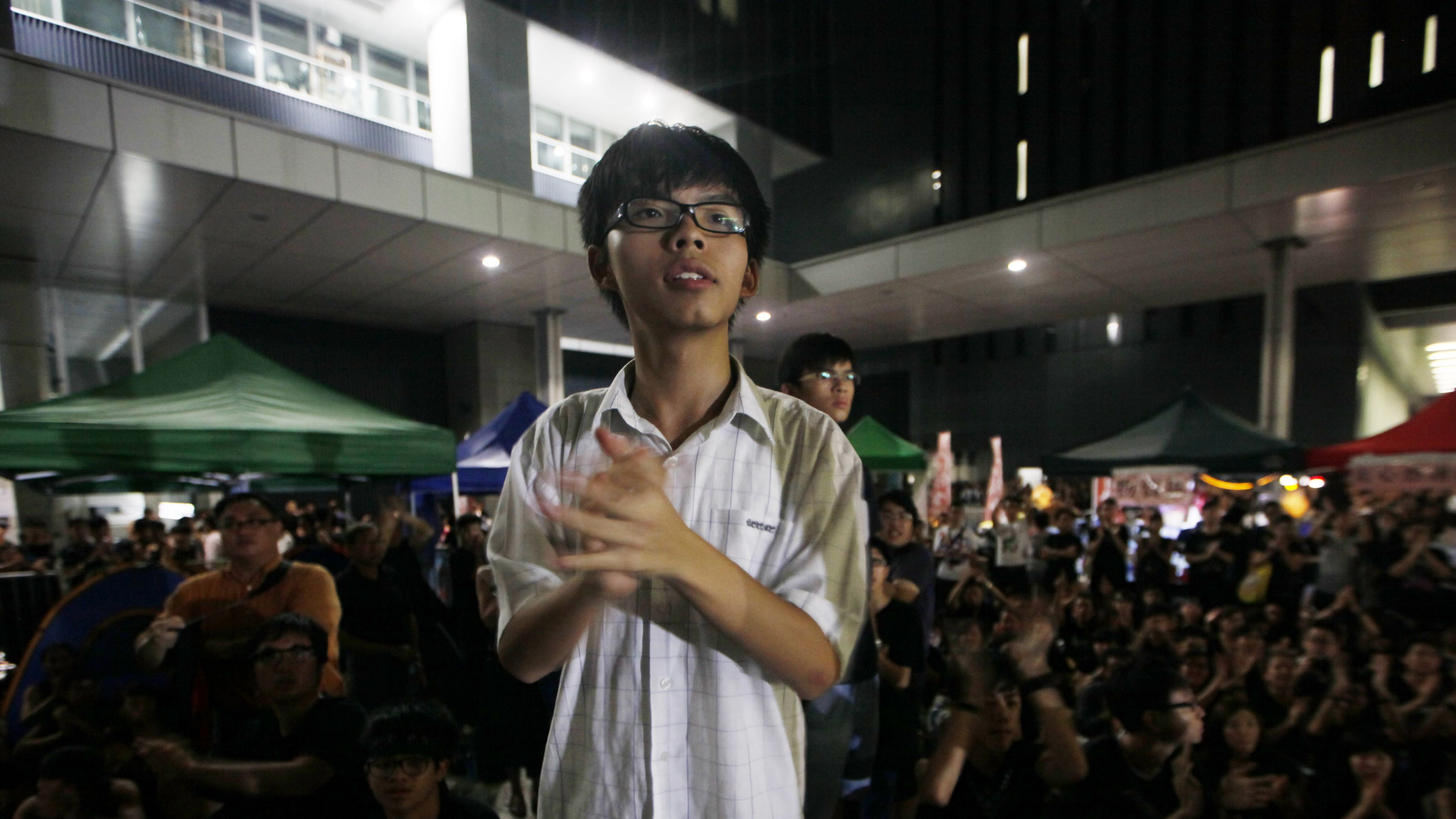 """Convener of the students group """"Scholarism"""" Joshua Wong attends a sit-in protest outside the government headquarters in Hong Kong, Wednesday, Sept. 5, 2012. Protesters urged the government to cancel new additional course, """"Moral and National Education"""" subject, to be introduced for school curriculum, starting from a new school year. (AP Photo/Kin Cheung"""