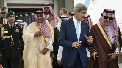 U.S. Secretary of State John Kerry (2nd R) speaks with Saudi Arabia's Foreign Minister Prince Saud al-Faisal (R) at King Abdulaziz International Airport in Jeddah September 11, 2014. Kerry will press Arab leaders on Thursday to support President Barack Obama's plans for a new military campaign against Islamic State militants including help with greater overflight rights for U.S. warplanes. REUTERS/Brendan Smialowski/Pool