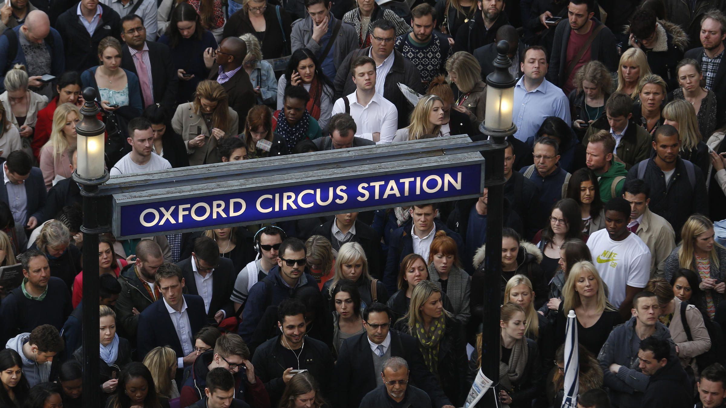 Commuters and shoppers queue for access to Oxford Circus underground station, one of the open tube stations, during strikes in London April 29, 2014. Millions of commuters faced transport chaos on Tuesday after eleventh-hour talks failed to avert a two-day strike on the London Underground train network over plans to cut jobs and close ticket offices. REUTERS/Luke MacGregor (BRITAIN - Tags: TRANSPORT BUSINESS EMPLOYMENT POLITICS SOCIETY)