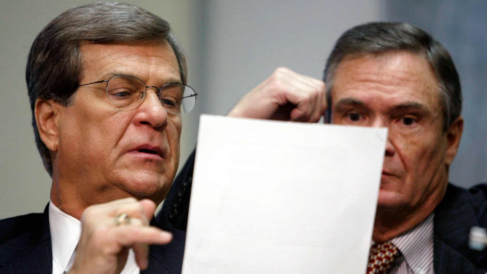 Senator Trent Lott (R-MS) points something out to Senator John Breaux (D-LA) during a hearing with commissioners of the Federal Communications Commission before the Senate Commerce, Science and Transportation Committee January 14, 2003. The hearing was held to discuss issues involving the troubled telecommunications industry.