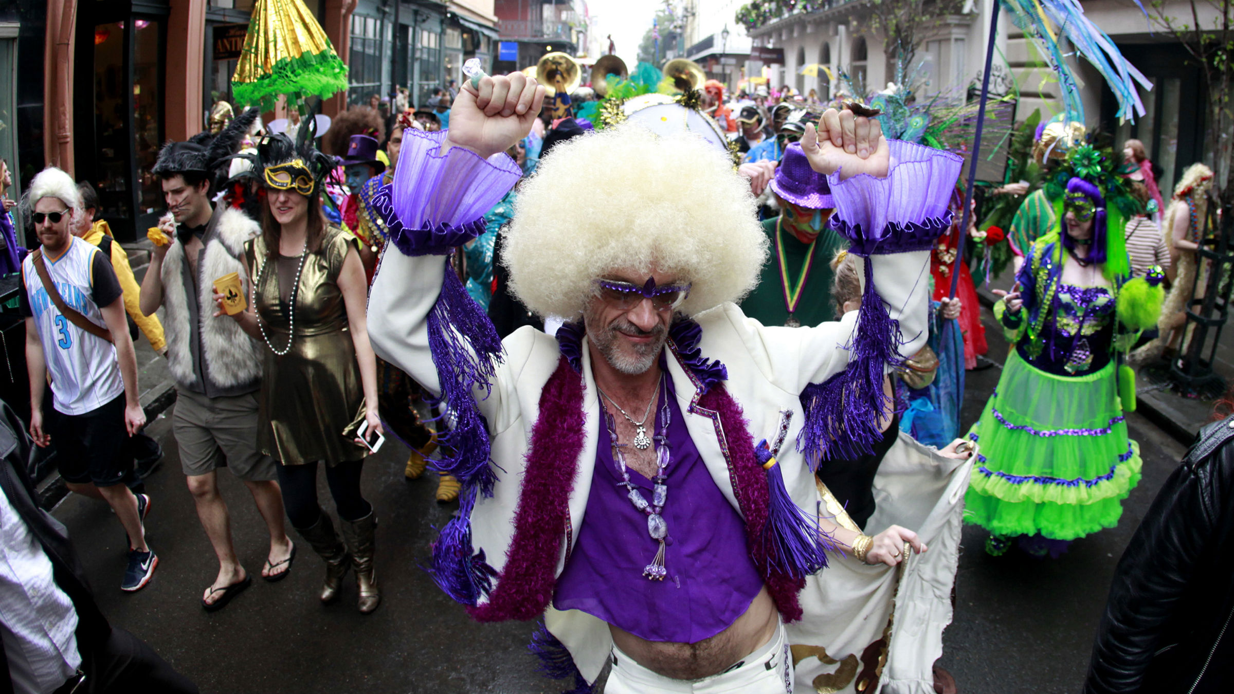 Revelers parade through the French Quarter on Mardi Gras Day in New Orleans, Louisiana February 12, 2013.