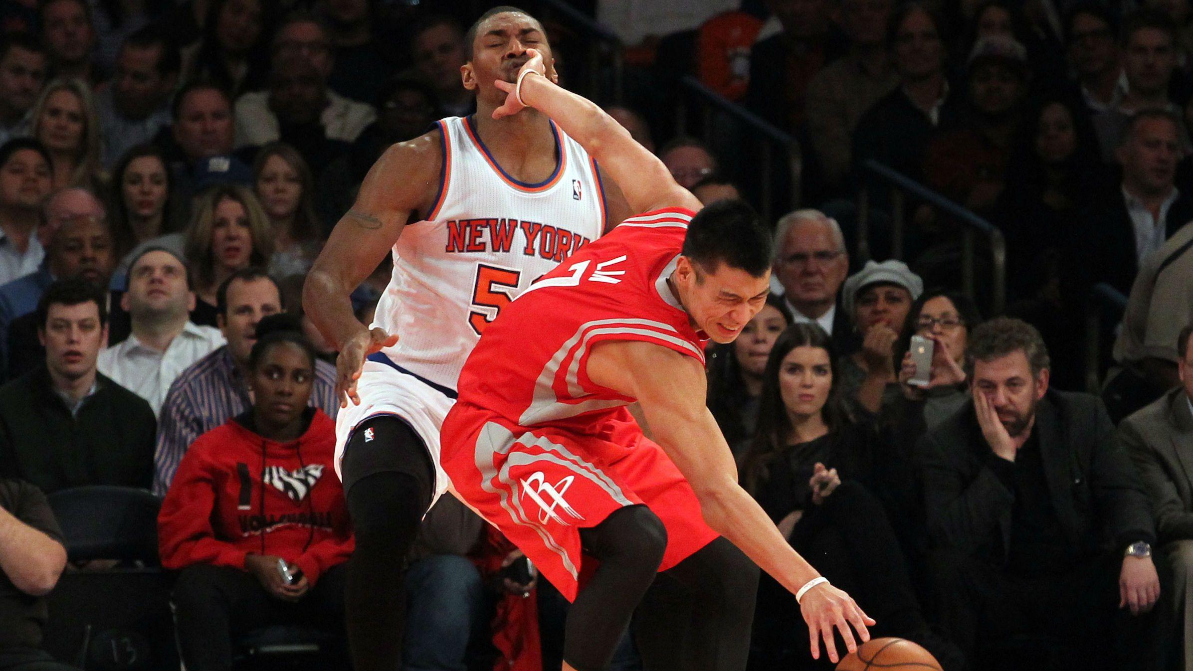 Houston Rockets point guard Jeremy Lin (7) is fouled by New York Knicks small forward Metta World Peace