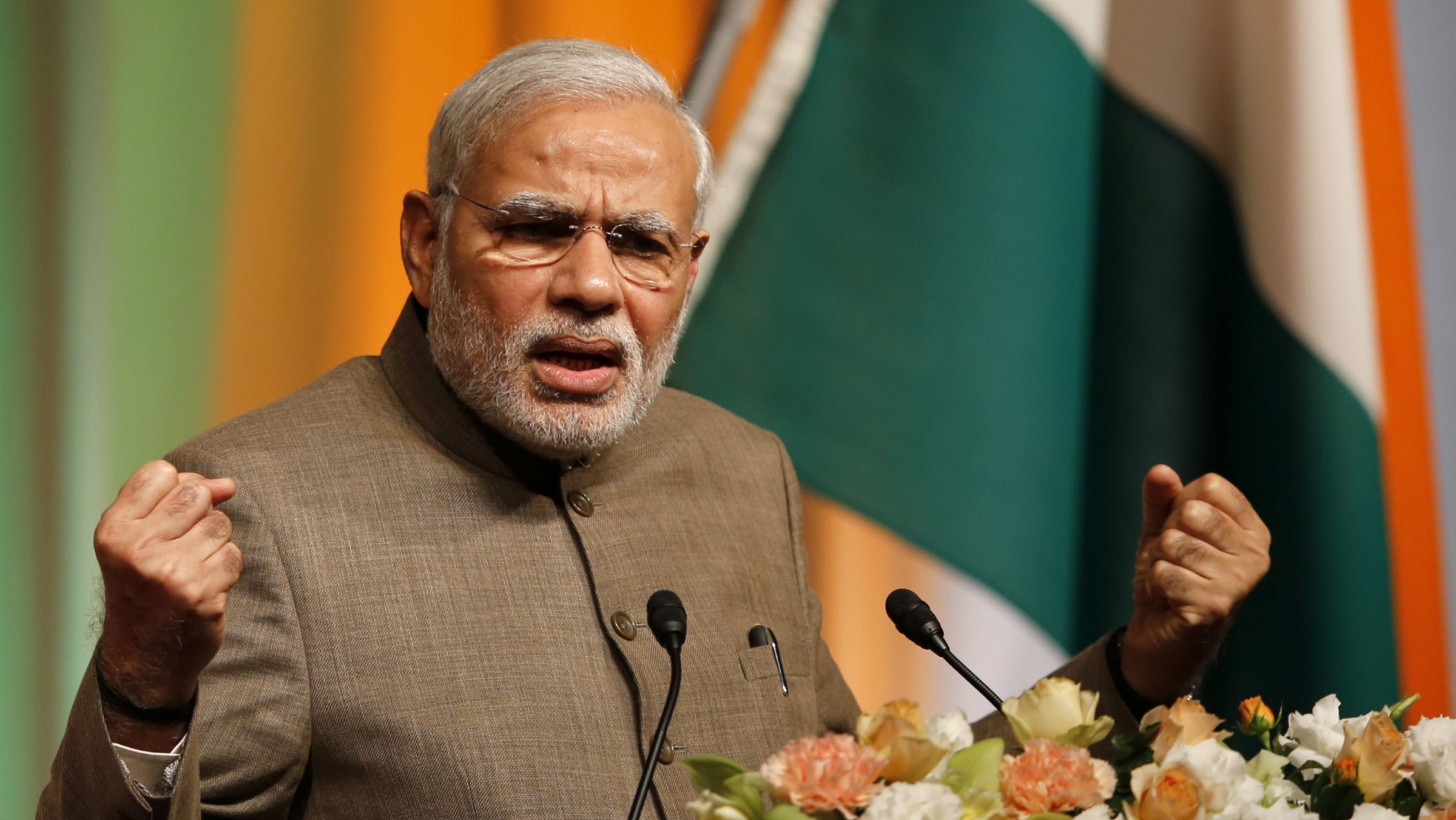 India's Prime Minister Narendra Modi gives a speech during his lecture meeting hosted by Nikkei Inc. and Japan External Trade Organization (JETRO) in Tokyo September 2, 2014. Modi, on his first major foreign visit since a landslide election win in May, arrived on Saturday for a five-day trip aimed at capitalising on his personal affinity with Japan's Prime Minister Shinzo Abe to bolster security and business ties. REUTERS/Toru Hanai