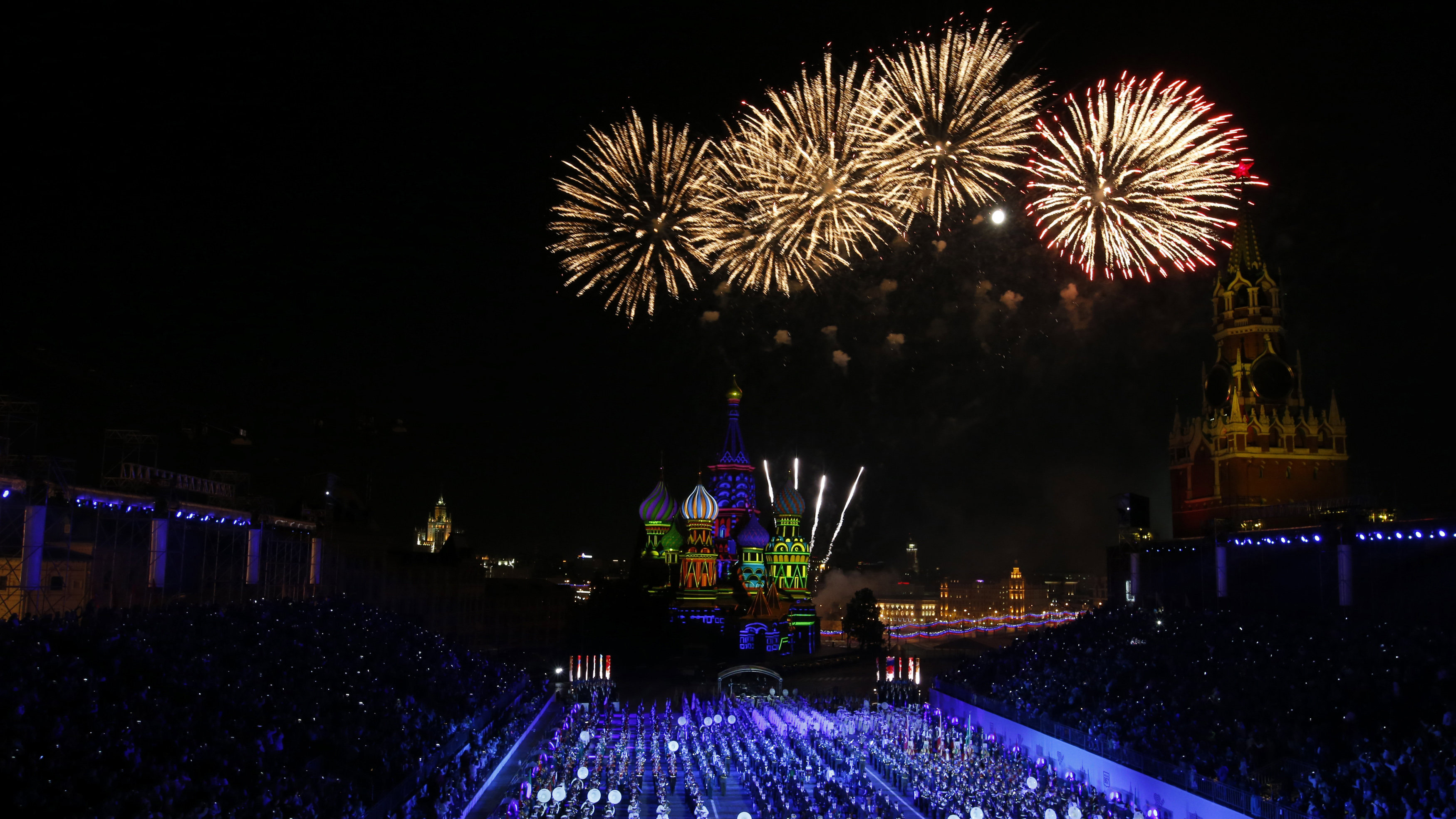 "Fireworks explode above Saint-Basil's cathedral during the final day of the International Military Music Festival ""Spasskaya Tower"" in Red Square in Moscow September 7, 2014."