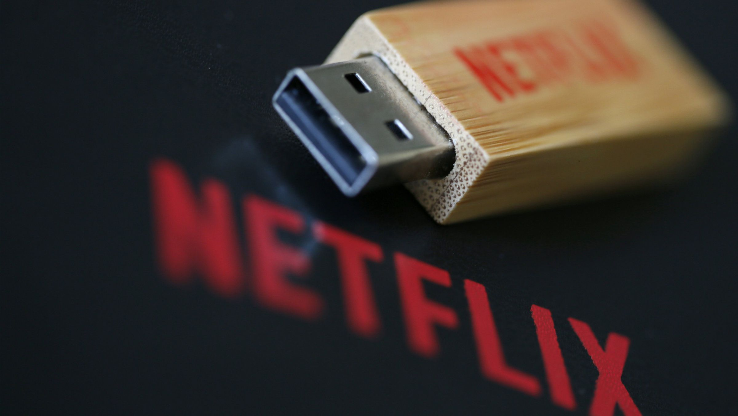 An USB key with the logo of Netflix, the American provider of on-demand Internet streaming media, is seen in Paris September 15, 2014.