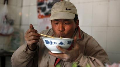 opiate opium heroin drug narcotic noodle morphine food safety xi'an china ganmian A migrant worker eats noodles in a local restaurant in Shanghai March 11, 2010. REUTERS/Nir Elias