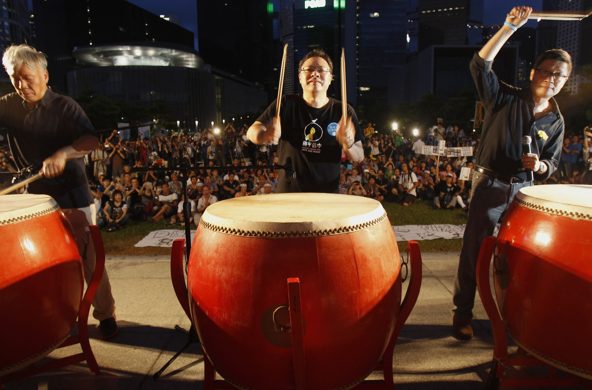 Founders of the Occupy Central civil disobedience movement (L-R), Reverend Chu Yiu-ming, academic Benny Tai and academic Chan Kin-man, hit drums during a campaign to kick off the movement in front of the financial Central district in Hong Kong August 31, 2014