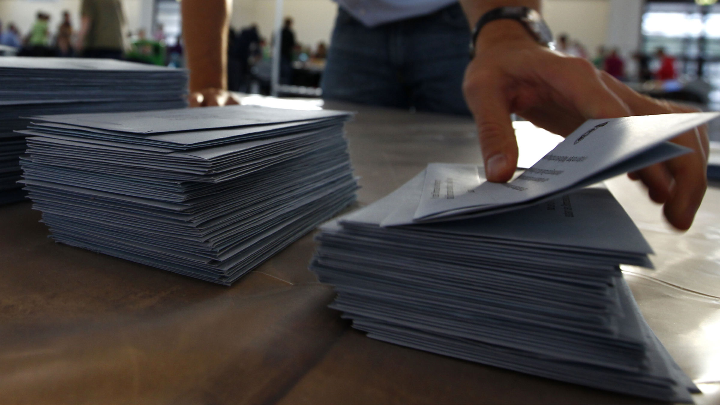Electoral officials sort ballot papers after the conclusion of voting in the German general election (Bundestagswahl) at the Messe in Munich September 22, 2013.