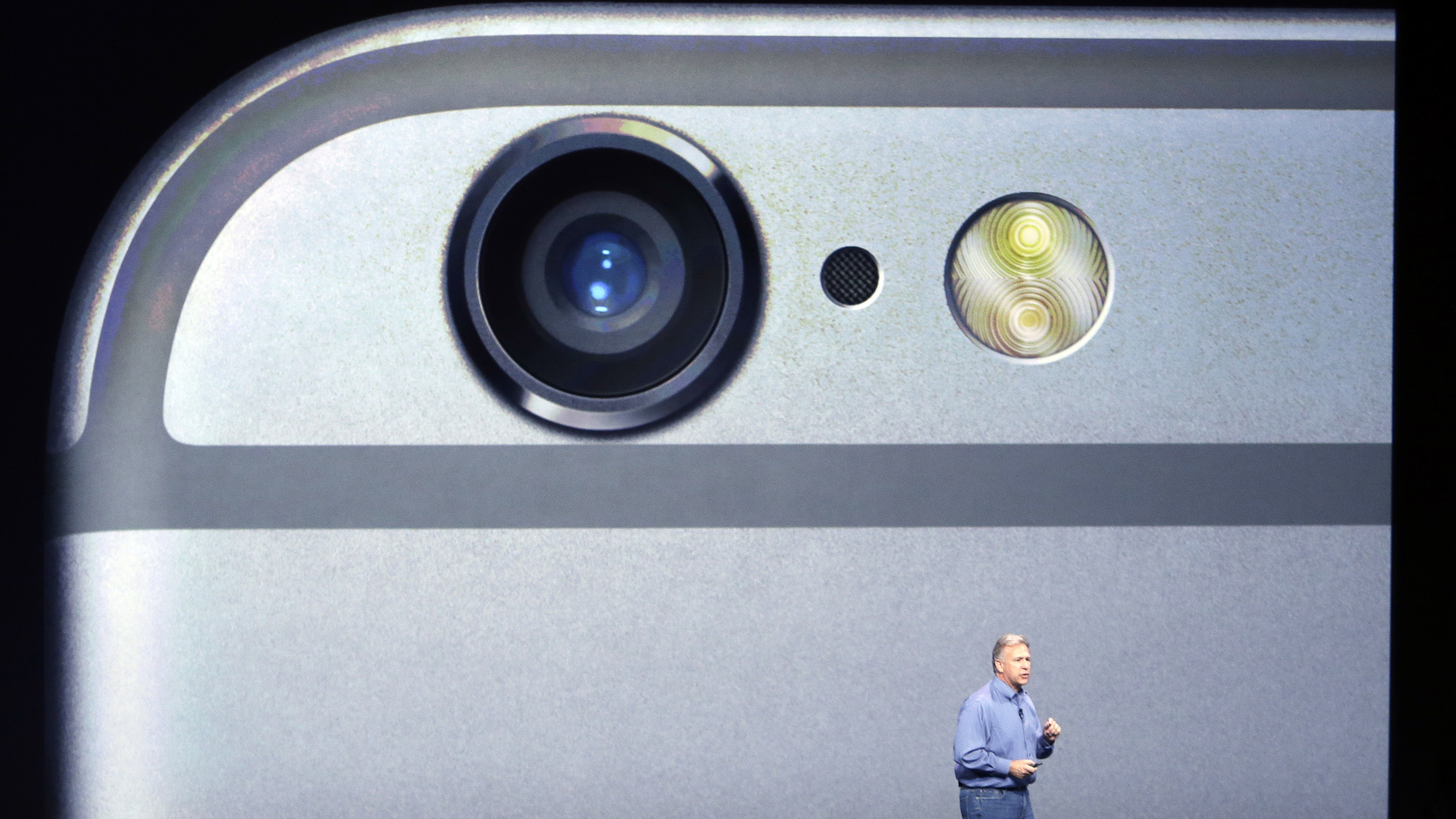Phil Schiller, Apple's senior vice president of worldwide product marketing, discusses the camera features on the new iPhone 6 and iPhone 6 plus on Tuesday, Sept. 9, 2014, in Cupertino, Calif. (AP Photo/Marcio Jose Sanchez)