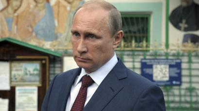 Russian president Vladimir Putin leaves the Life-giving Trinity church in Moscow, September 10, 2014.