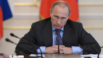 Russian president Vladimir Putin presides over a meeting on July 30, 2014.