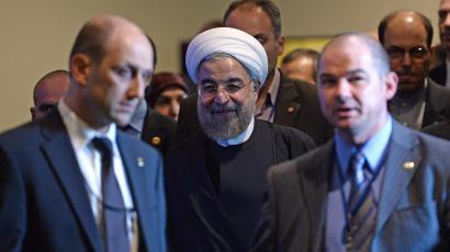 Iran's President Hassan Rouhani is escorted for a meeting with U.N. Secretary-General Ban Ki-moon on the sidelines of the U.N. General Assembly in New York September 23, 2014.
