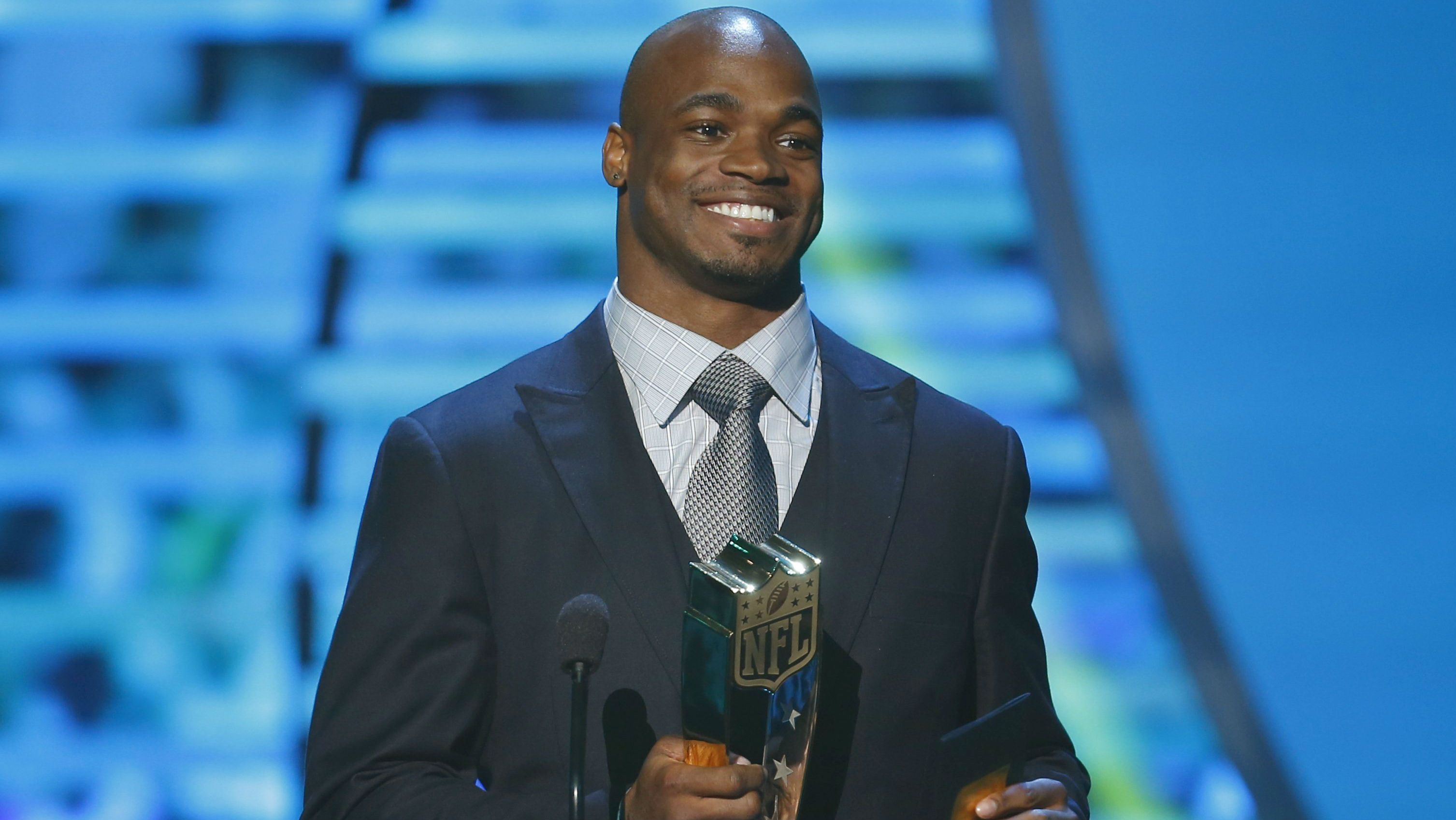 Minnesota Vikings running back Adrian Peterson accepts the NFL MVP award during the NFL Honors awards show in New Orleans, Louisiana February 2, 2013. REUTERS/Jeff Haynes (UNITED STATES - Tags: SPORT FOOTBALL ENTERTAINMENT)