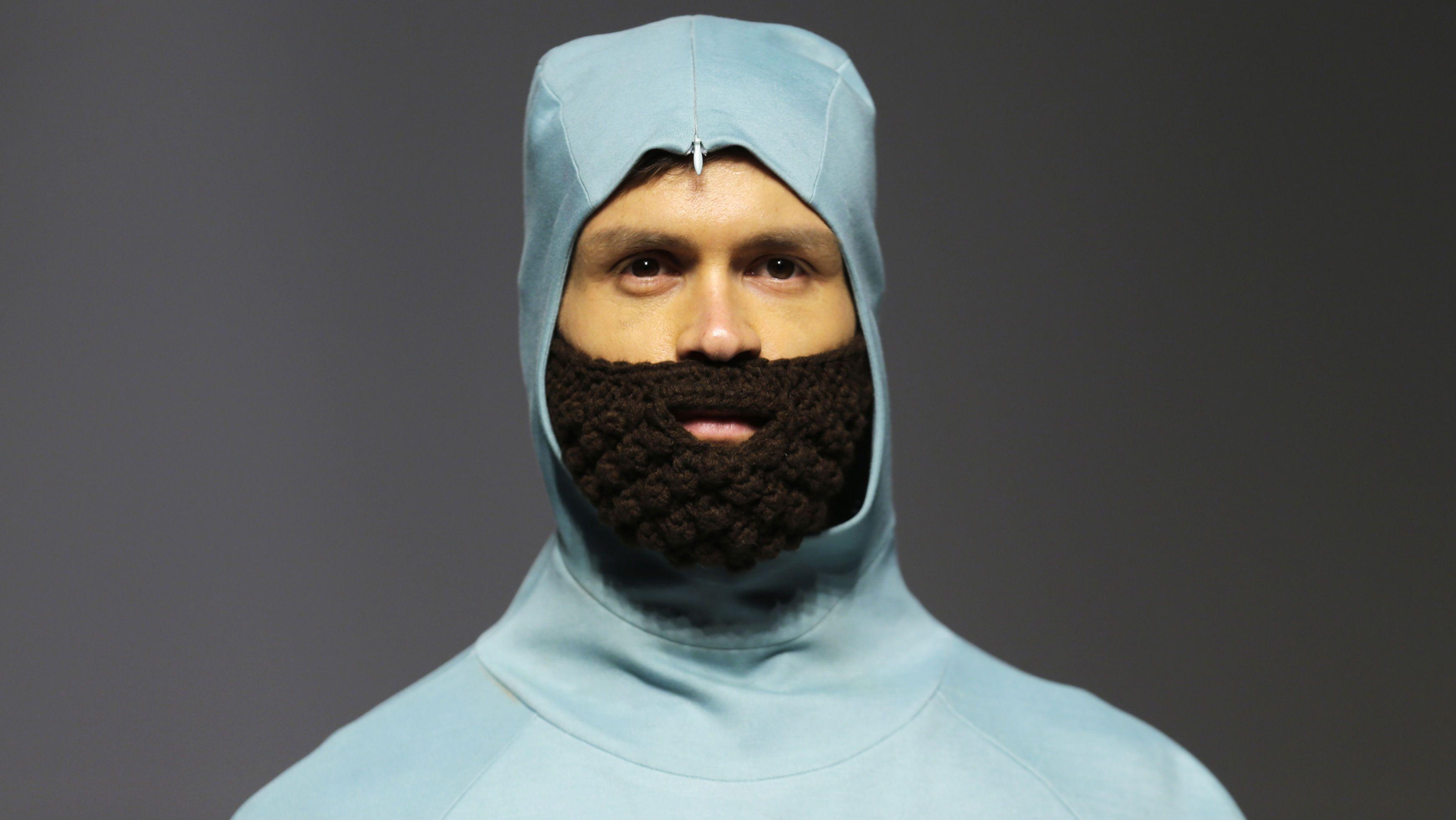 A man wears a knitted beard