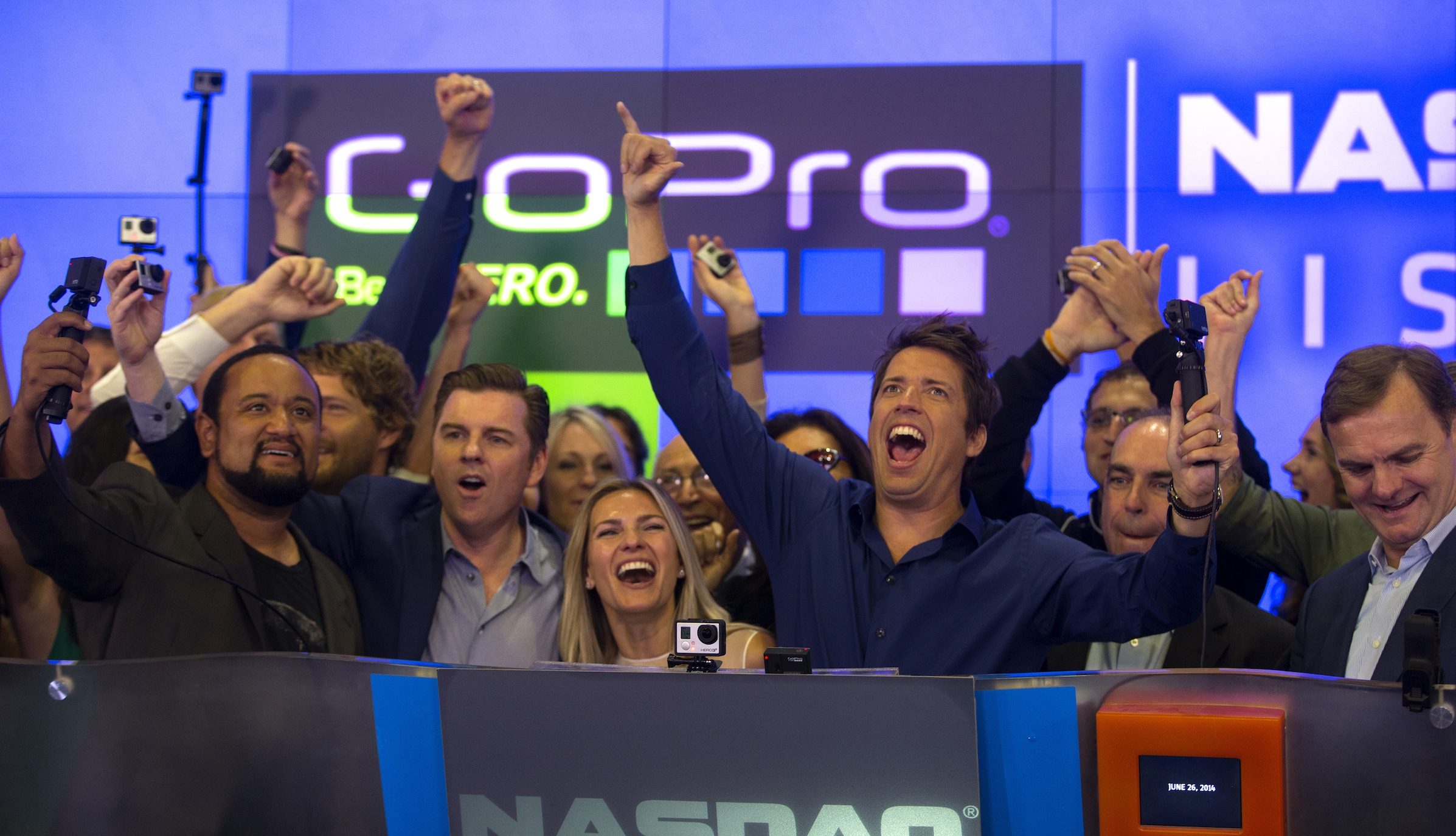 GoPro Inc's founder and CEO Nick Woodman (C) celebrates GoPro Inc's IPO as he rings the opening bell at the Nasdaq Market Site in New York City, June 26, 2014. Wearable sports camera maker GoPro Inc's initial public offering was priced at $24 per share, an underwriter said, valuing the company at up to $2.96 billion. REUTERS/Mike Segar (UNITED STATES - Tags: BUSINESS SCIENCE TECHNOLOGY) - RTR3VVN7