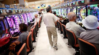 Visitors play at Dynam's pachinko parlour in Fuefuki, west of Tokyo June 19, 2014. Japan's once-booming pachinko industry, grappling with a greying customer base and the threat of new competition from casinos, is adopting a softer touch and smoke-free zones to lure a new generation of players, particularly women. Pachinko, a modified version of pinball, is a fading national obsession, with about 12,000 parlours nation-wide and one in thirteen people playing the game. But that figure is declining as the population shrinks and younger people prefer games on their mobile phones. Picture taken June 19, 2014. REUTERS/Issei Kato (JAPAN - Tags: SOCIETY BUSINESS) ATTENTION EDITORS PICTURE 21 OF 26 FOR PACKAGE 'JAPAN'S PACHINKO PARLOURS' SEARCH 'KATO PACHINKO' FOR ALL IMAGES - RTR42WPZ