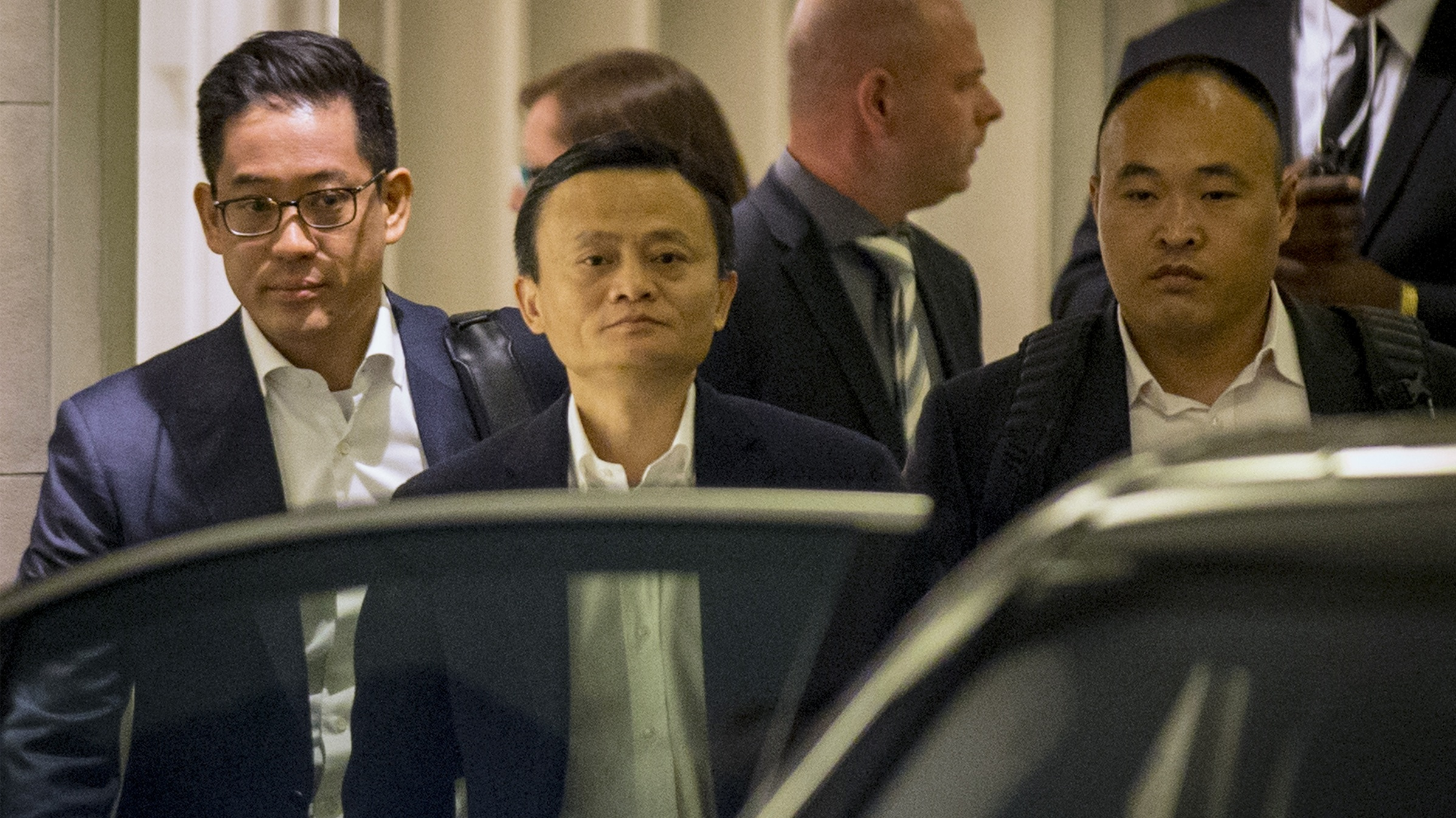 Jack Ma, the founder and executive chairman of Alibaba Group Holding, leaves following the company's road show in New York September 8, 2014. Hundreds of hedge funds, mutual funds and other institutional investors lined up on Monday to hear Alibaba Group Holding Ltd's management pitch the company's shares, as the Chinese e-commerce giant kicked off a two-week IPO marketing blitz.  REUTERS/Brendan McDermid (UNITED STATES - Tags: BUSINESS TPX IMAGES OF THE DAY) - RTR45F5S