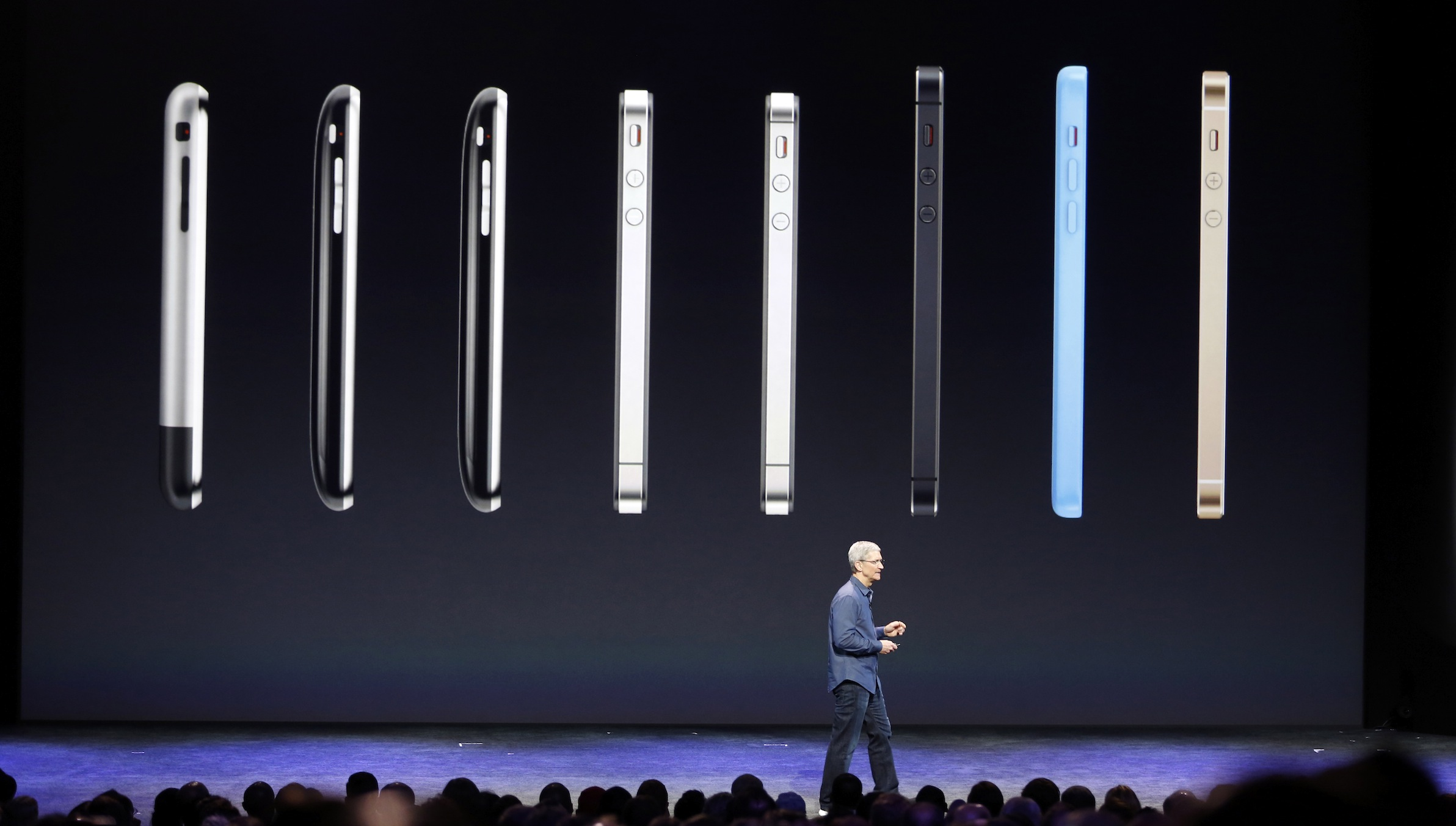 Apple Chief Executive (CEO) Tim Cook speaks on stage during an Apple event announcing the iPhone 6 and the iPhone 6 Plus at the Flint Center in Cupertino, California, September 9, 2014. REUTERS/Stephen Lam  (UNITED STATES - Tags: BUSINESS SCIENCE TECHNOLOGY TELECOMS) - RTR45LFA