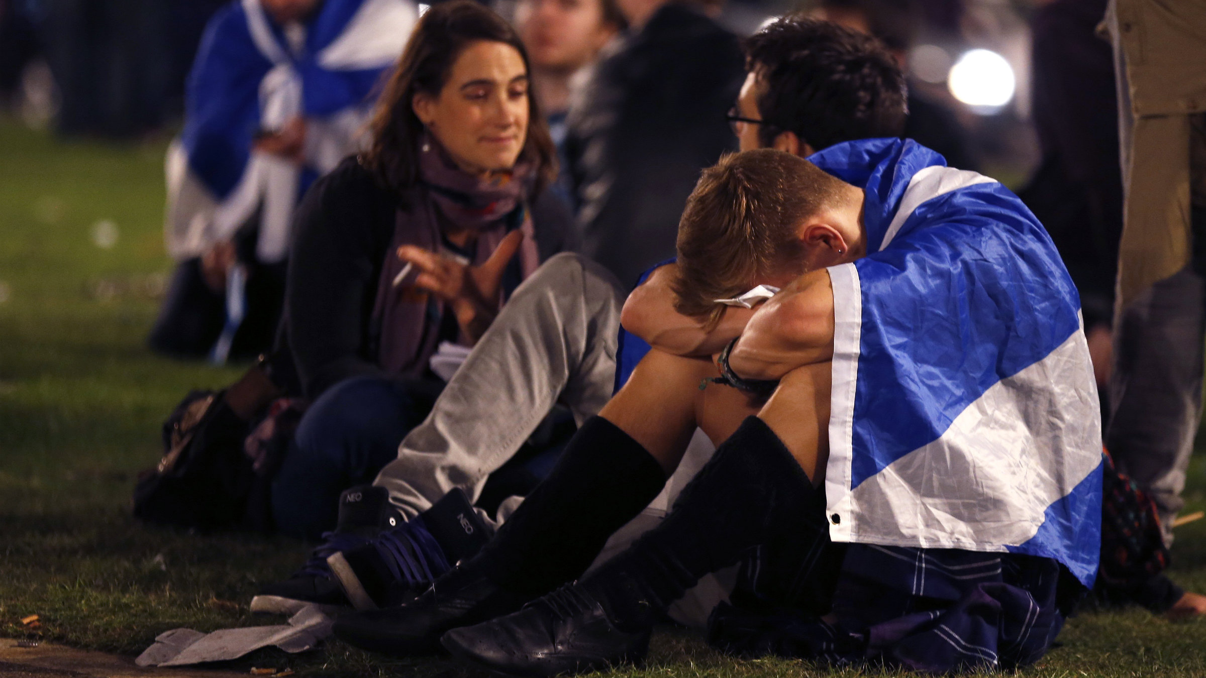 """Supporters from the """"Yes"""" Campaign react as they sit in George Square in Glasgow, Scotland September 19, 2014."""