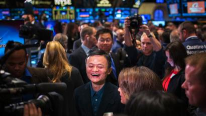"Alibaba Group Holding Ltd. founder Jack Ma reacts on the floor of the New York Stock Exchange before the company's initial public offering (IPO) under the ticker ""BABA"", in New York September 19, 2014. Alibaba Group Holding Ltd's shares surged by more than 40 percent in their first day of trading on Friday as investors jumped in to buy what looks likely to be the largest IPO in history. REUTERS/Lucas Jackson (UNITED STATES - Tags: BUSINESS SCIENCE TECHNOLOGY TPX IMAGES OF THE DAY) - RTR46YF6"