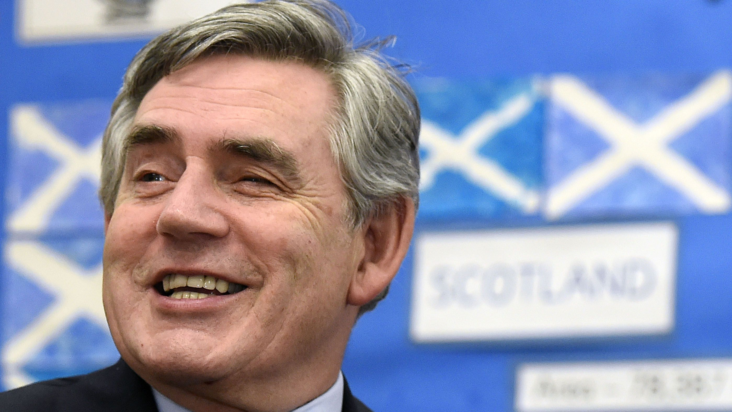 Former British Prime Minister Gordon Brown speaks to pupils during a visit to Kelty Primary School in Fife , Scotland September 19, 2014. Scotland spurned independence in a historic referendum that threatened to rip the United Kingdom apart, sow financial turmoil and diminish Britiain's remaining global clout. REUTERS/Garry F McHarg/Pool (BRITAIN - Tags: POLITICS ELECTIONS)