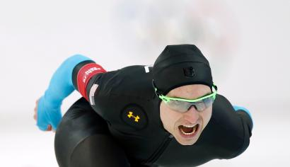Jonathan Kuck of the U.S. competes in the men's 1,500 metres speed skating race during the 2014 Sochi Winter Olympics, February 15, 2014. U.S. speed-skaters decided on Friday to drop new, specially designed Under Armour Inc suits that media reports have linked to a dismal showing at the Sochi Games, reverting to apparel worn during recent World Cup events. REUTERS/Issei Kato (RUSSIA - Tags: OLYMPICS SPORT SPEED SKATING) - RTX18VKT