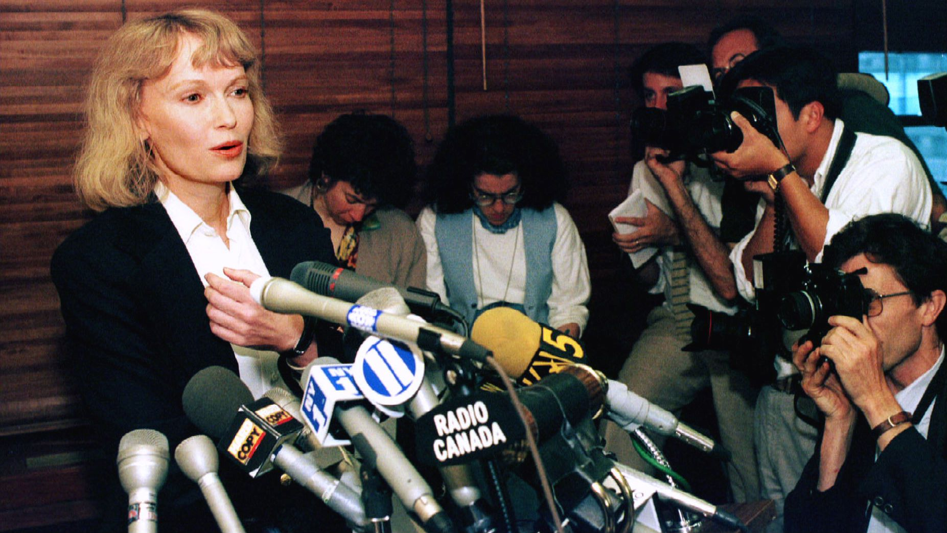 Actress Mia Farrow answers questions during a press conference in New York June 7, after being awarded custody of her three children with estranged lover Woody Allen. The couple who was together for almost 13 years was engaged in a bitter custody battle for adopted daughter Dylan, 7, adopted son Moses, 15, and biological son Satchel, 5