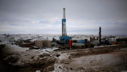 An oil derrick is seen at a fracking site for extracting oil outside of Williston, North Dakota.