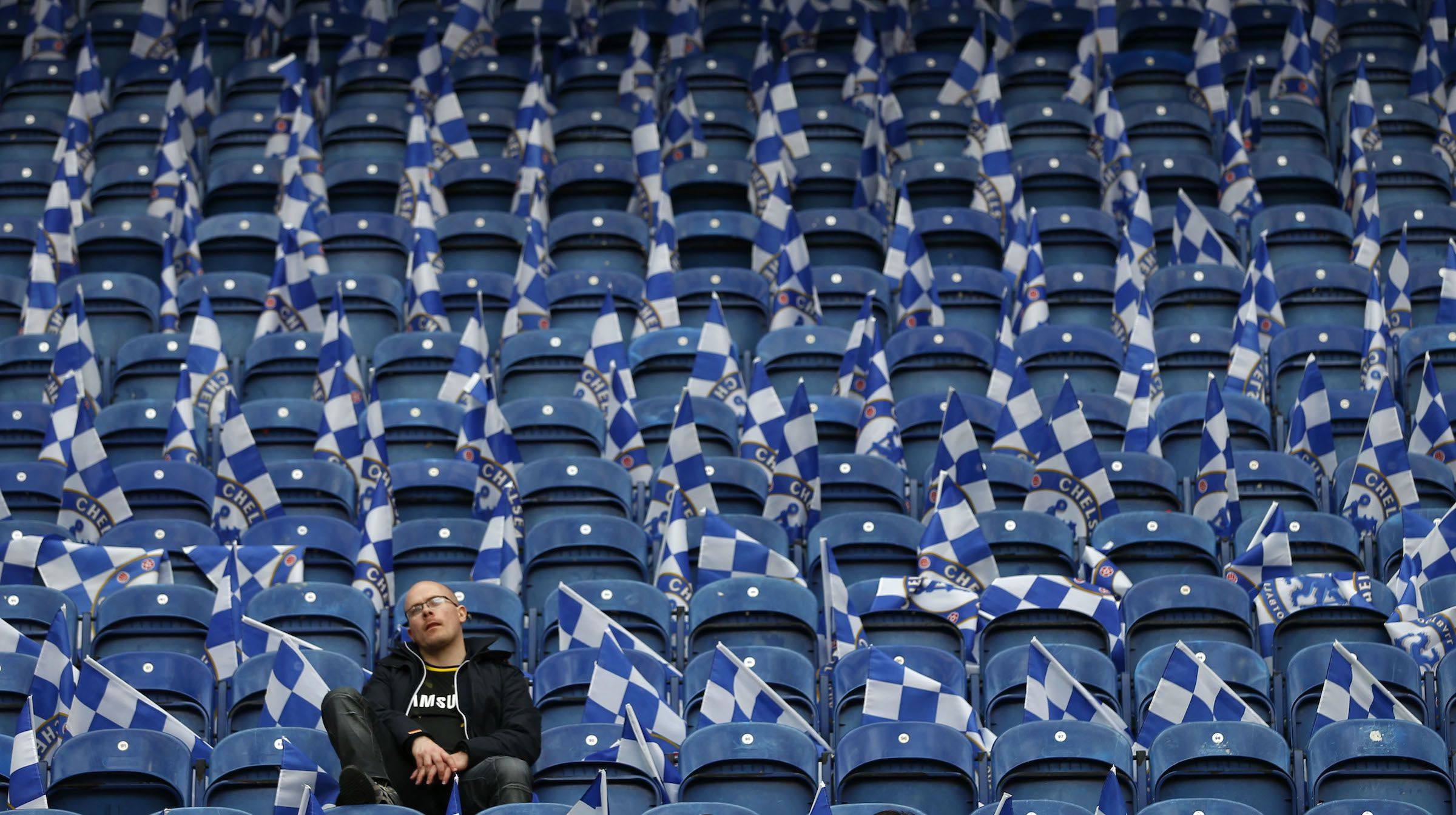 A Chelsea fan sits in the stands before the Europa League final soccer match against Benfica at the Amsterdam Arena May 15, 2013. REUTERS/Eddie Keogh (NETHERLANDS - Tags: SPORT SOCCER) - RTXZNOL