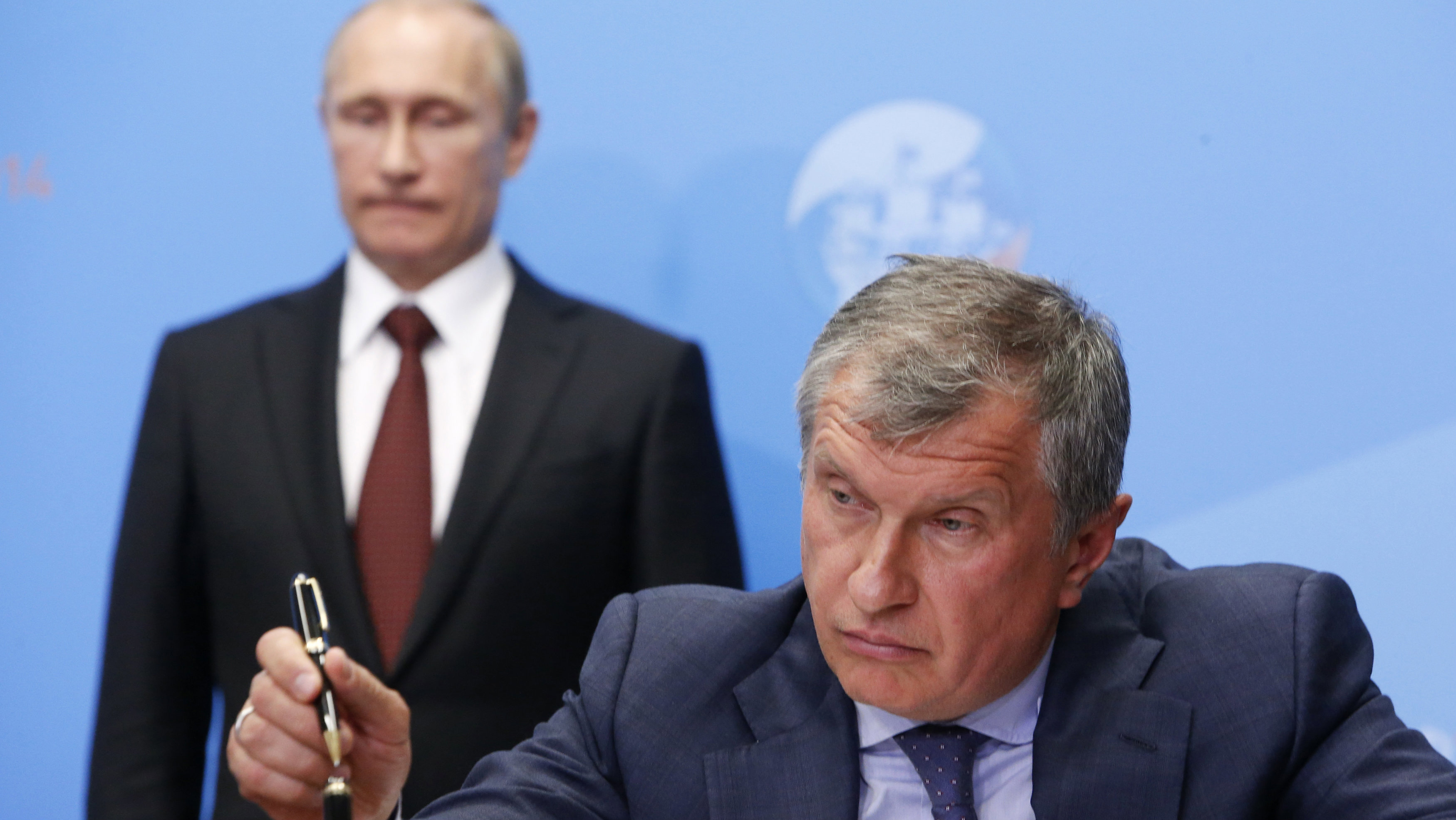 Rosneft CEO Igor Sechin finishes signing a document in St. Petersburg in May 2014.