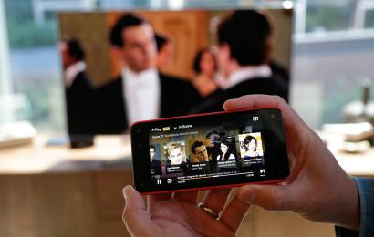 "his June 18, 2014 file photo shows the ""second screen"" feature on the Amazon Fire Phone when connected with a compatible television, in Seattle."