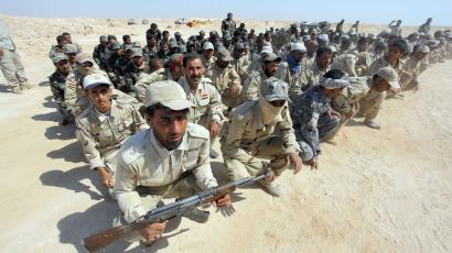 Shi'ite fighters, who have joined the Iraqi army to fight against militants of the Islamic State, formerly known as the Islamic State of Iraq and the Levant (ISIL)