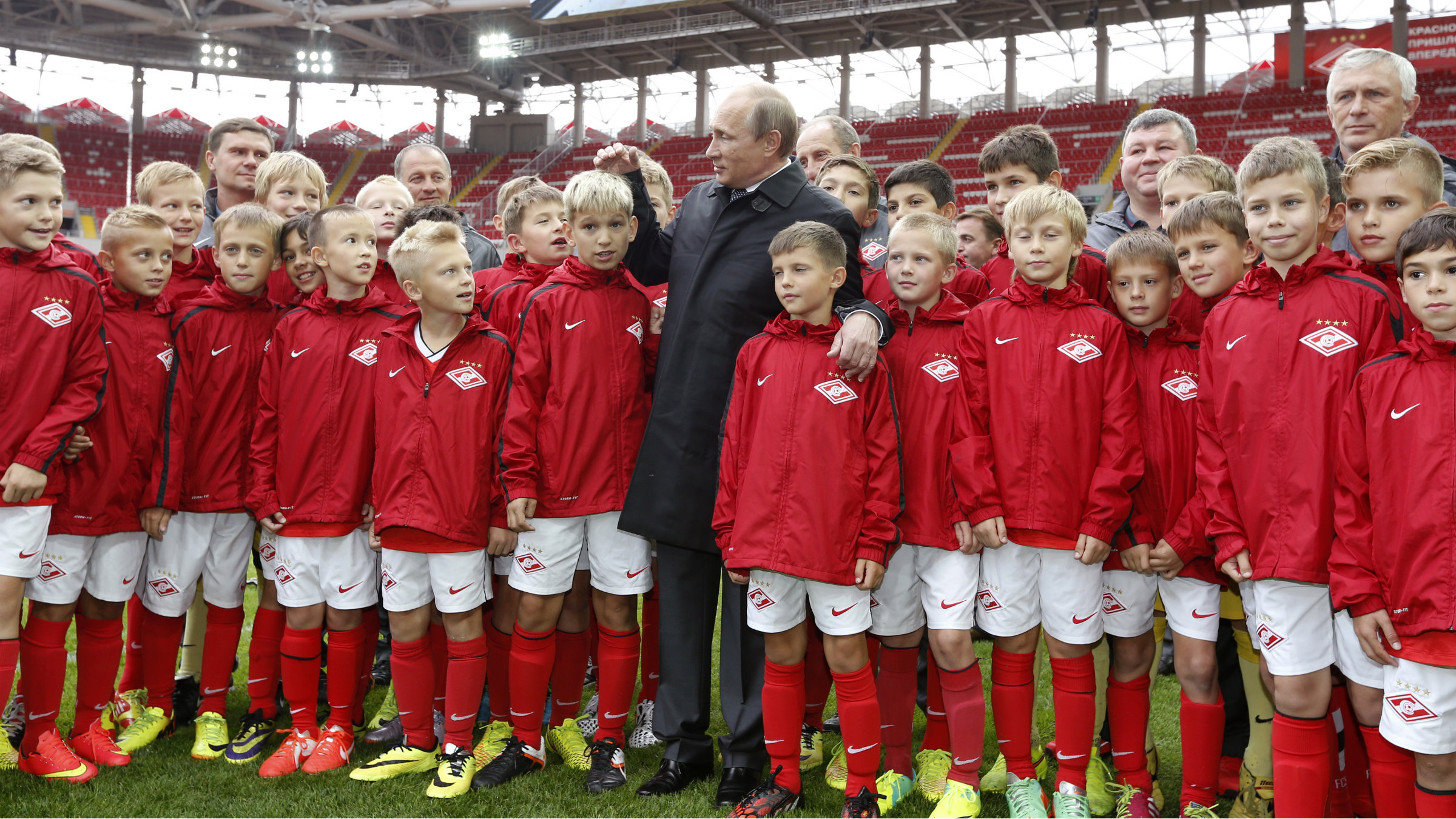 Russian president Vladimir Putin visits with young Russian football players in Moscow on Aug. 27, 2014.