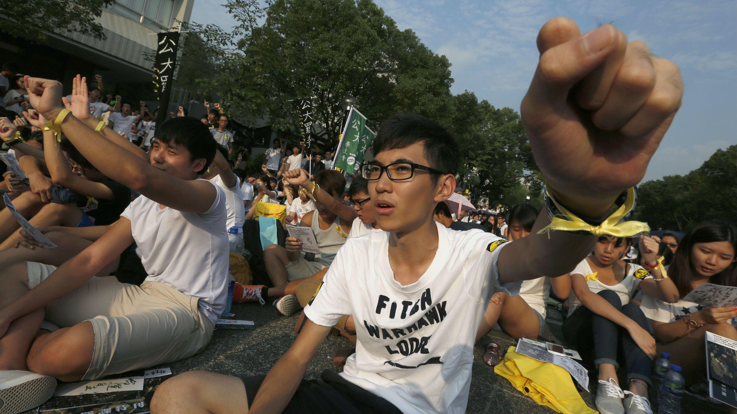 University students chant slogans at the Chinese University of Hong Kong as they boycott classes in Hong Kong September 22, 2014