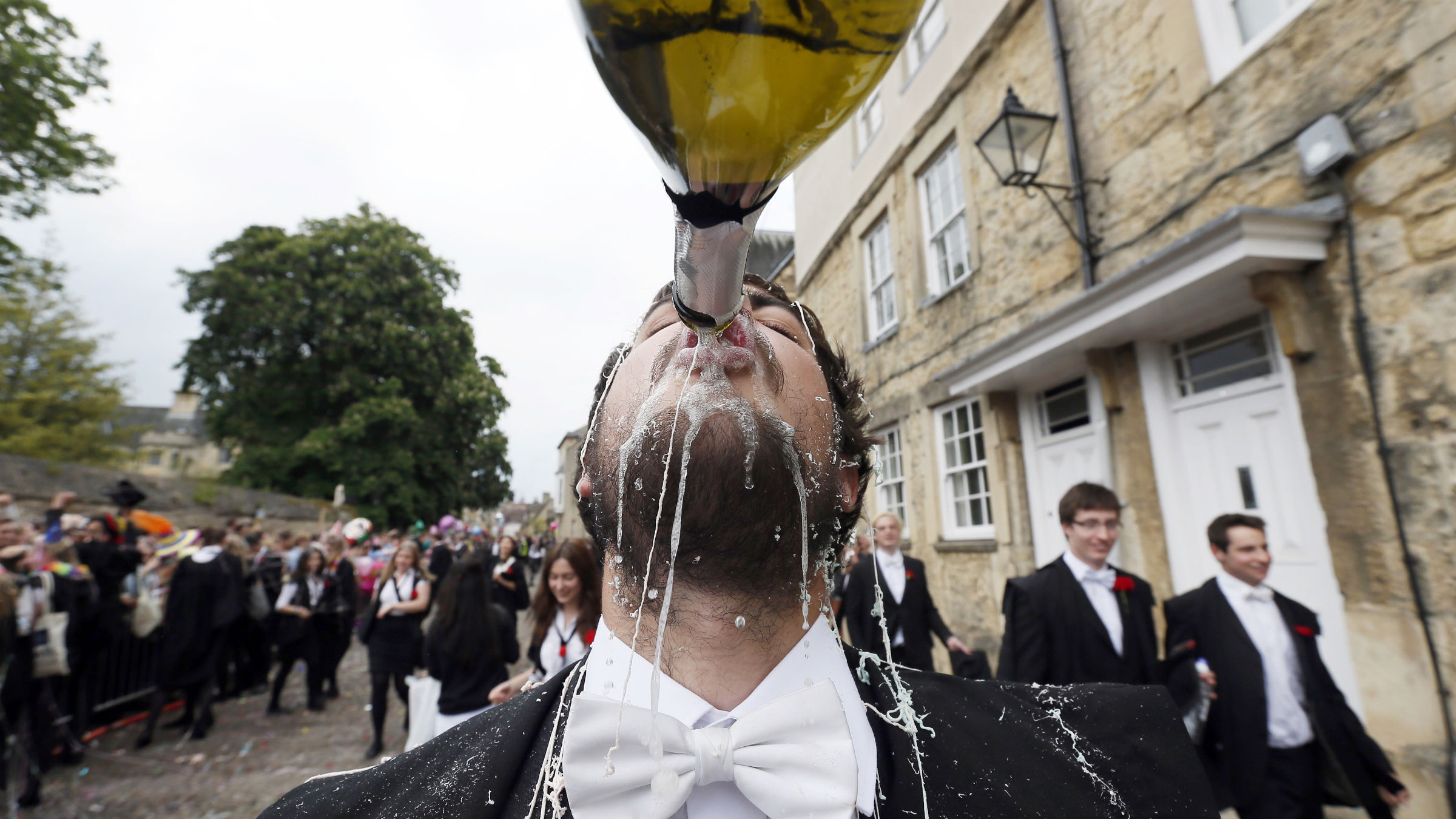 """A student from University College Oxford gets """"trashed"""" after finishing his exams in Oxford, southern England June 7, 2013. Trashing is the practice at Oxford University where students have all manner of messy items thrown at them by their contemporaries after finishing their exams."""